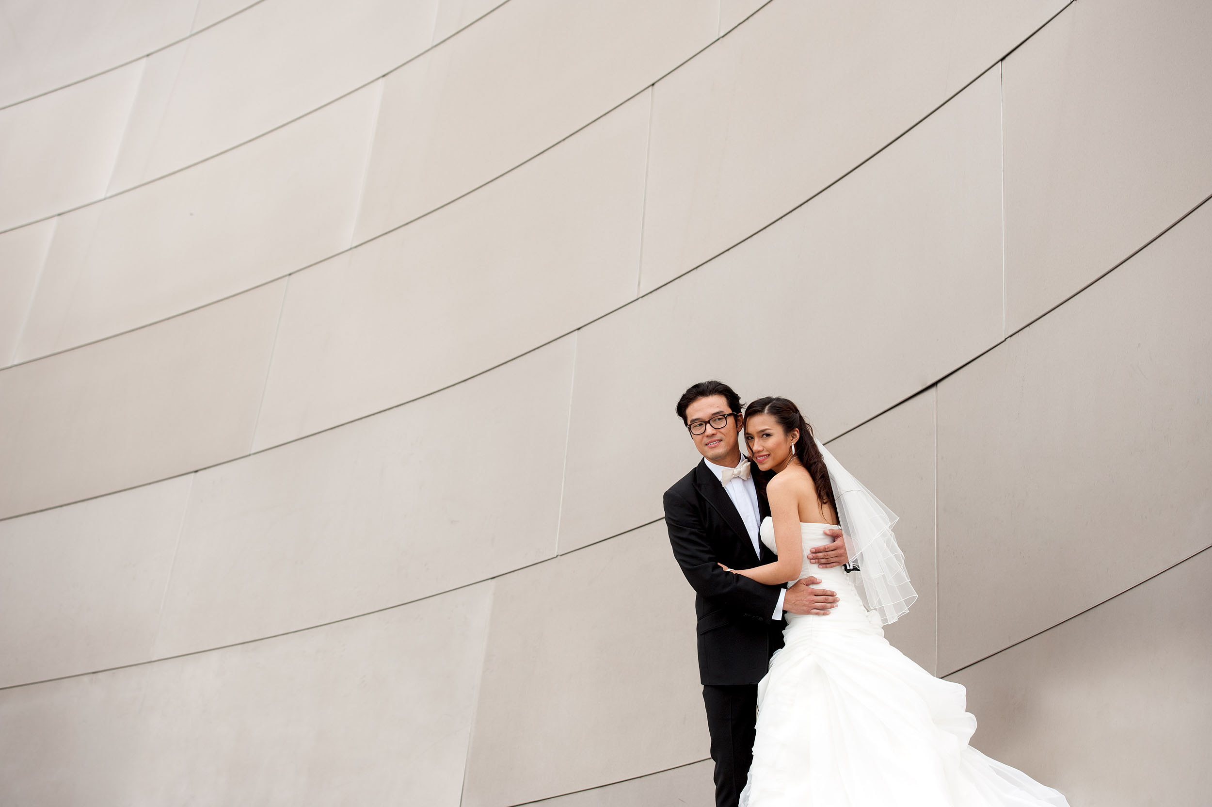 Bride and groom at the Walt Disney Concert Hall in Los Angeles.