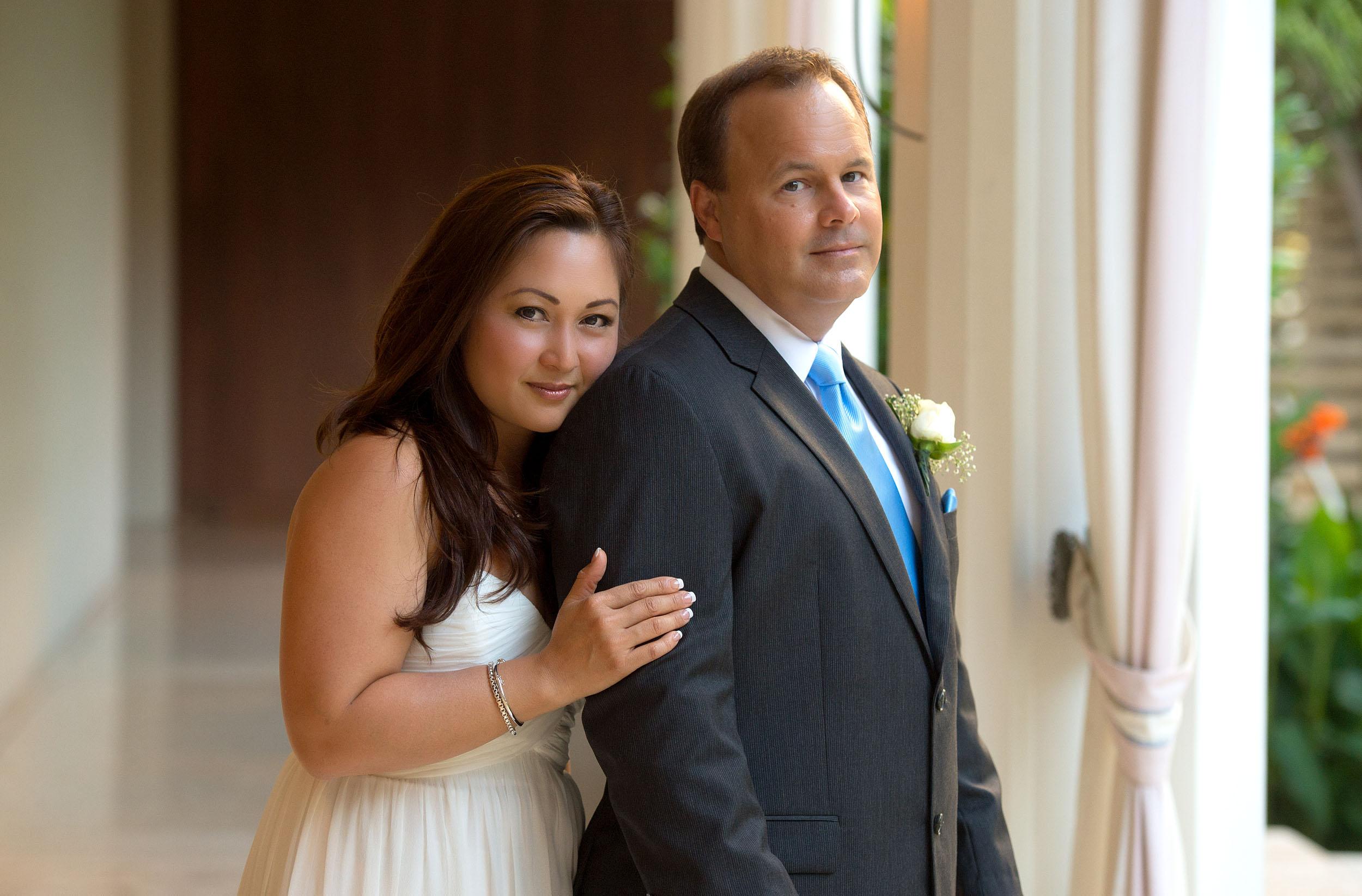 Bride and groom portrait at the Halekulani Hotel in Honolulu.