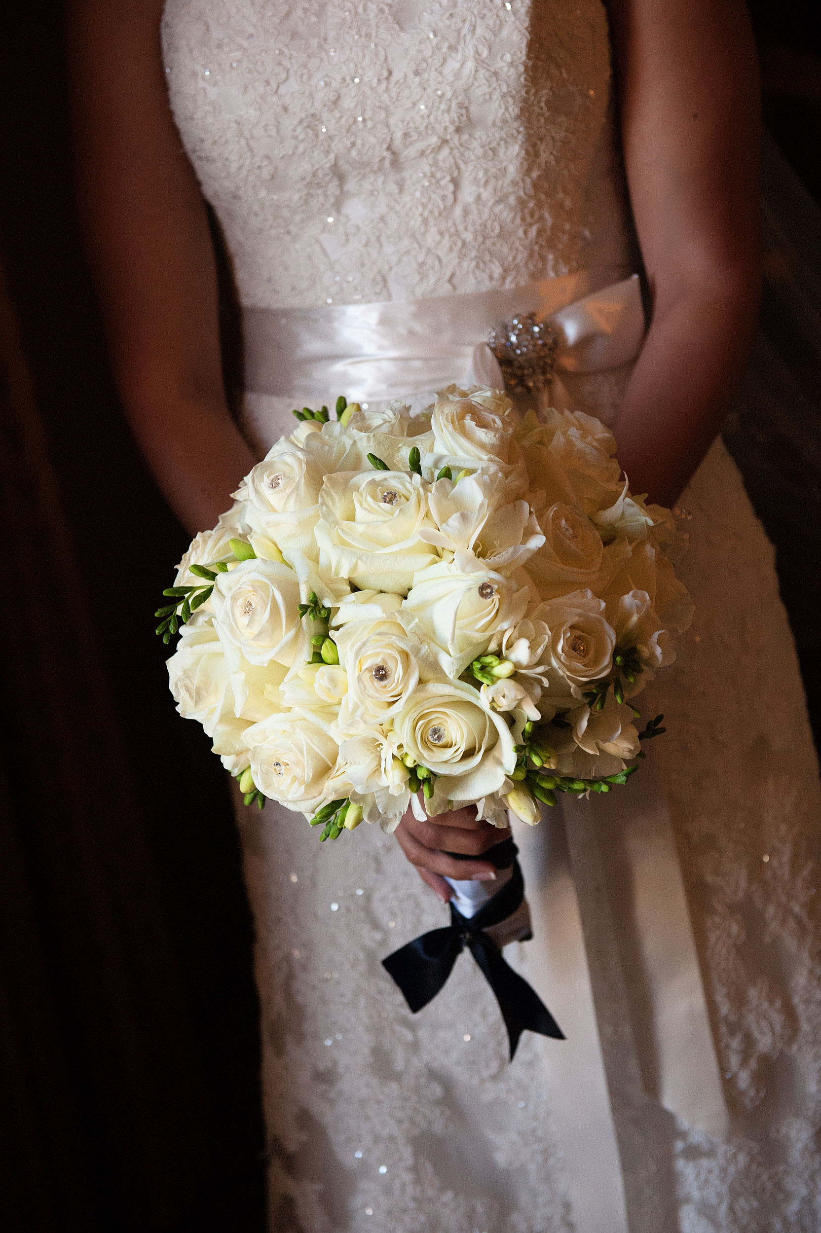 Bride in wedding dress holding bouquet.