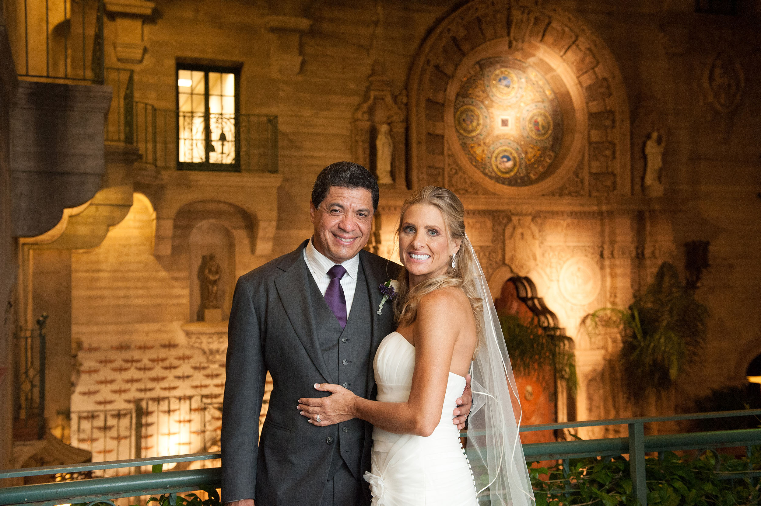 Bride and groom at night at the Mission Inn Hotel & Spa in Riverside.