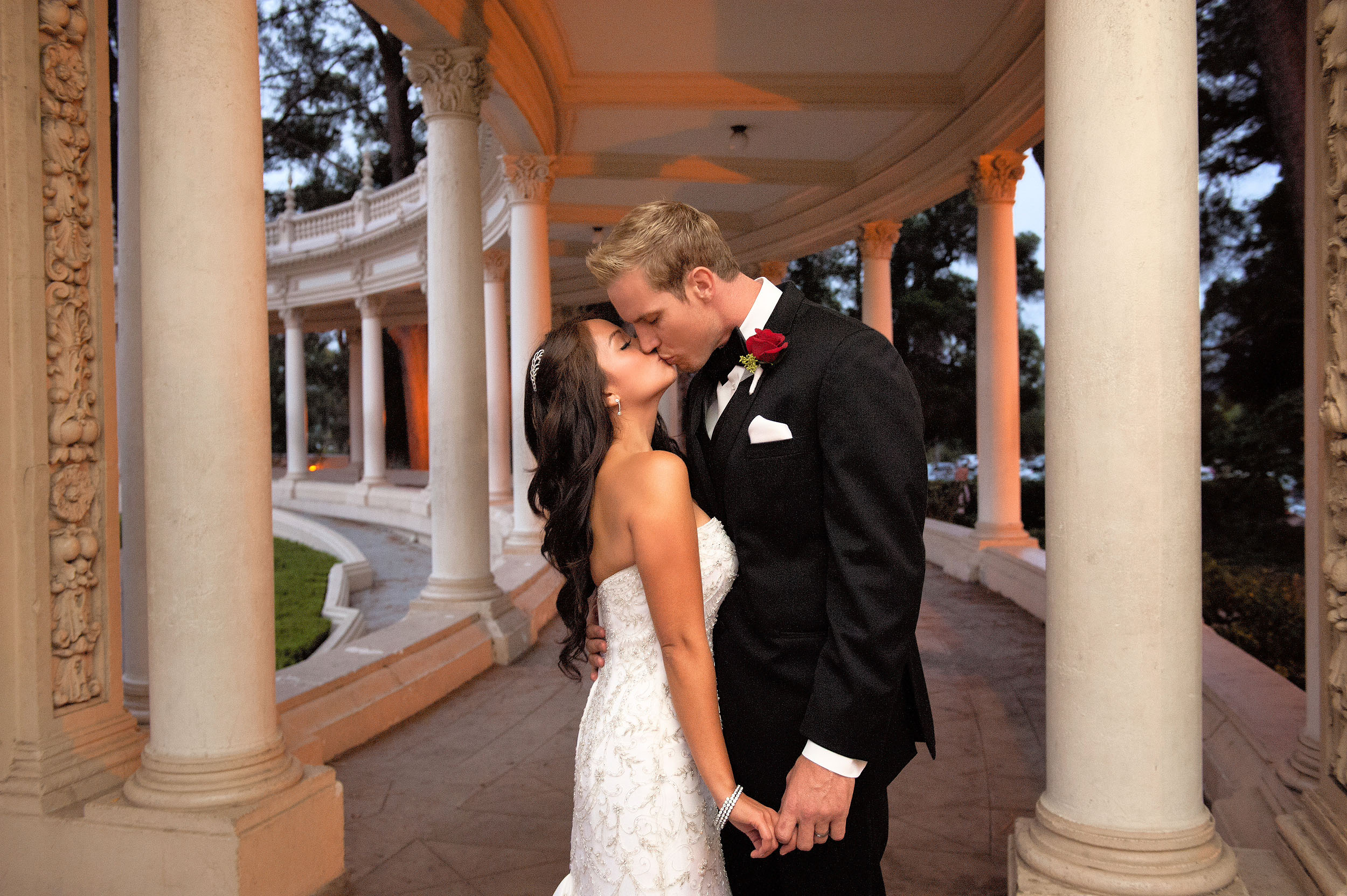 Bride and groom kissing at Balboa Park's Spreckels Theatre in San Diego.
