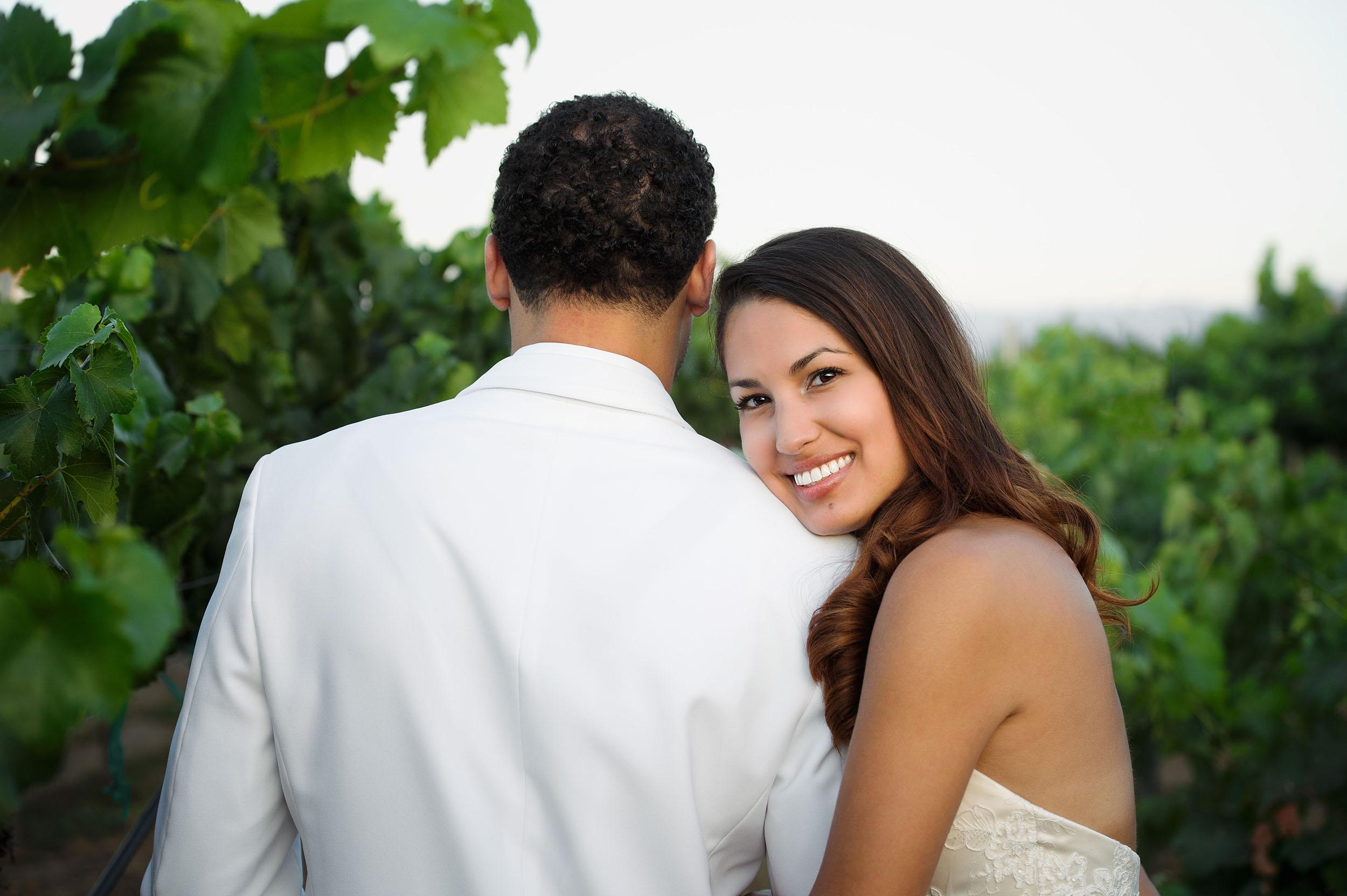 Bride and groom in the vineyards of Wien Family Cellars in Temecula.