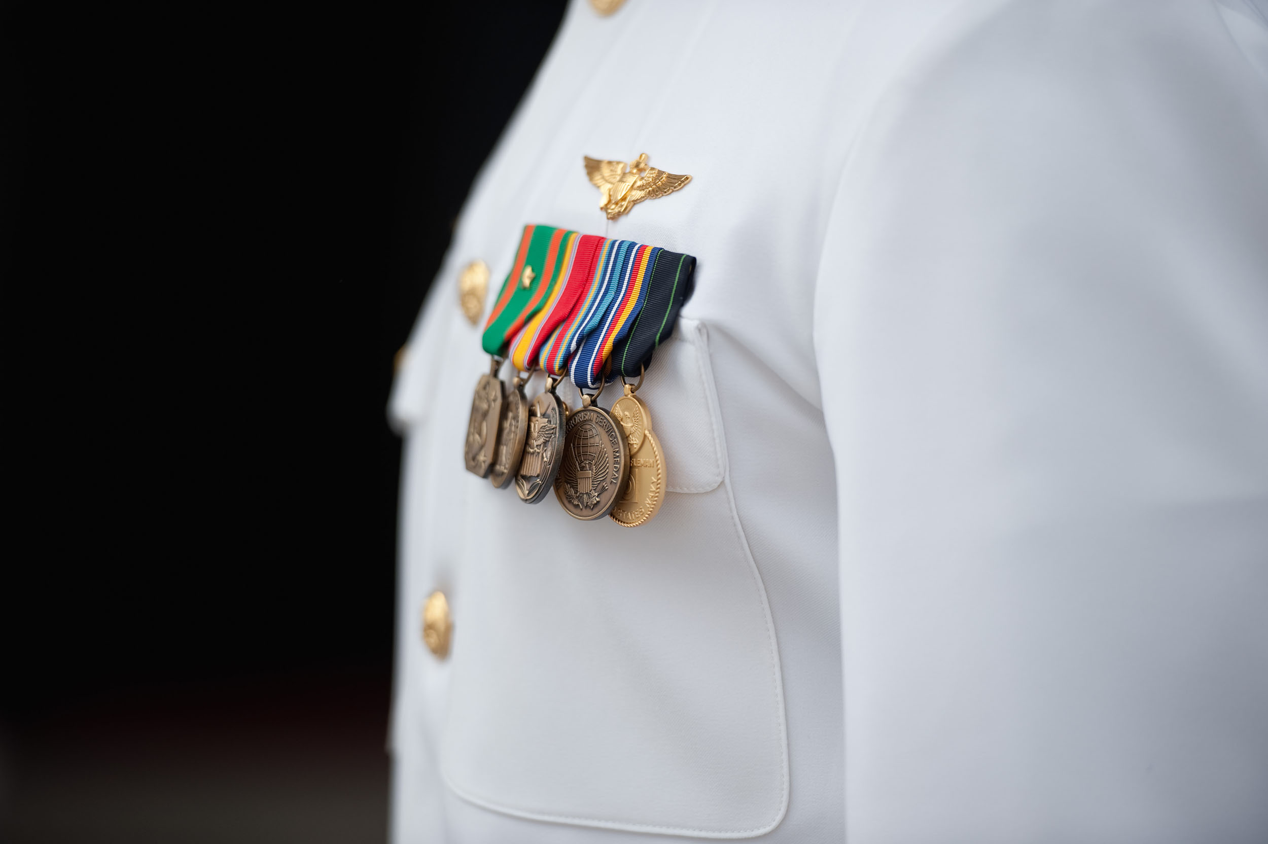 Groom in Naval Officer Dress Uniform with medals at Our Lady of the Rosary Roman Catholic Church.