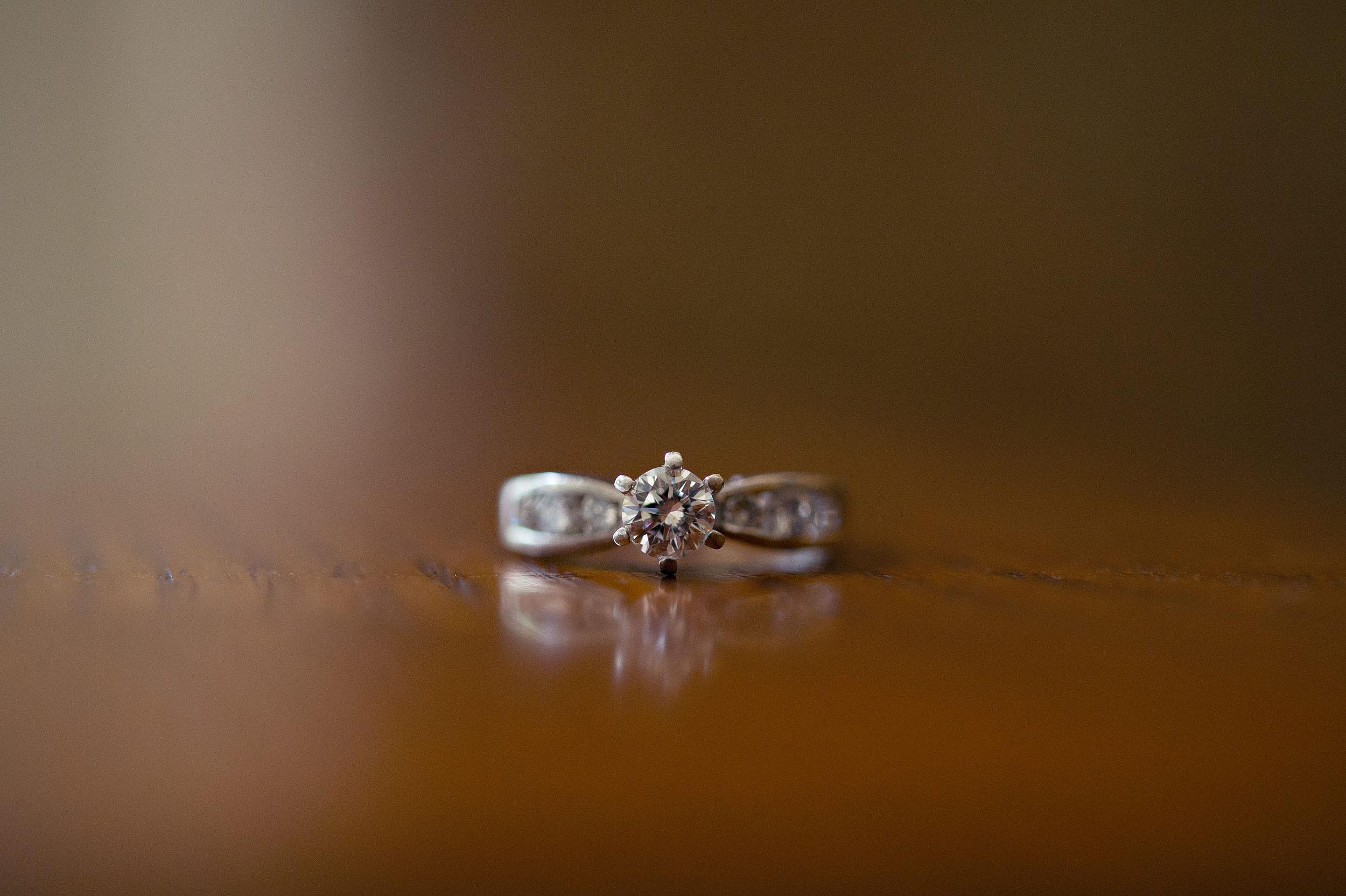Bride's diamond solitaire wedding ring.