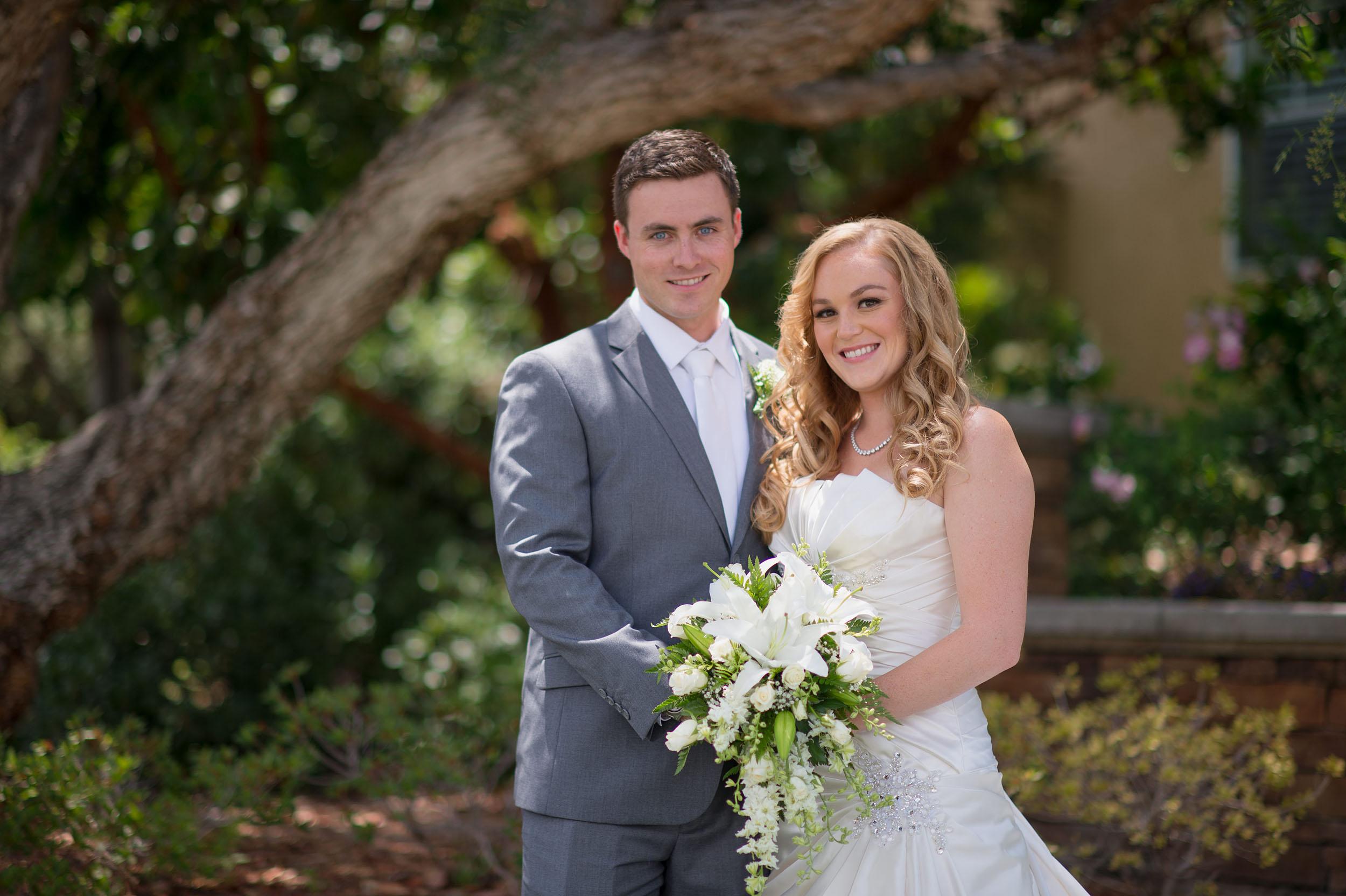 Bride and groom with bouquet in Santa Clarita.