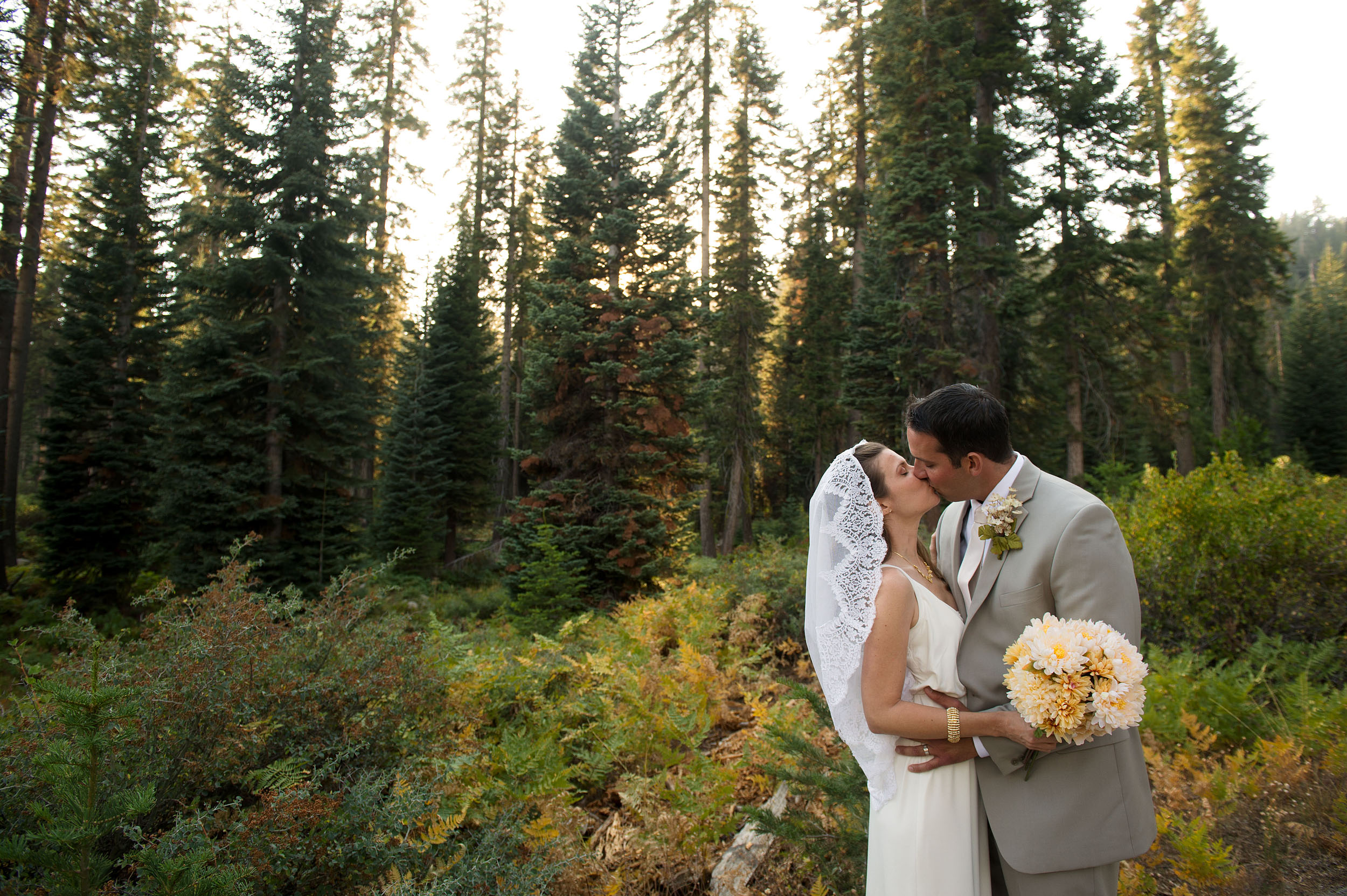 Bride and groom kissing at the Wuksachi Lodge at Sequoia and Kings Canyon National Parks.