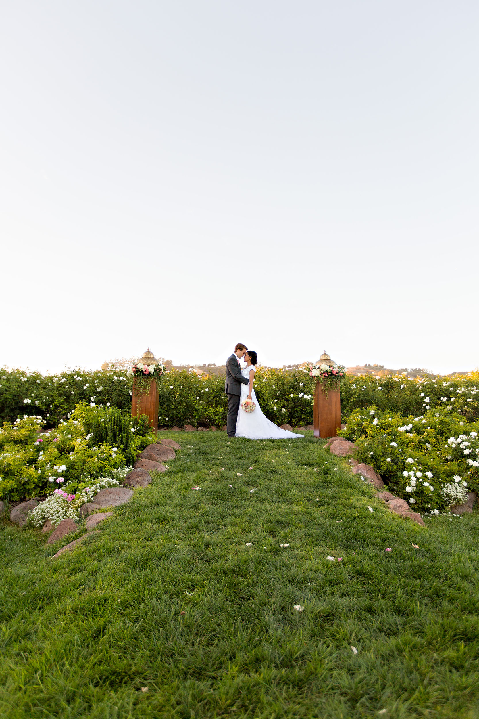 Bride and groom kissing in the distance at Gerry Ranch in Camarillo.