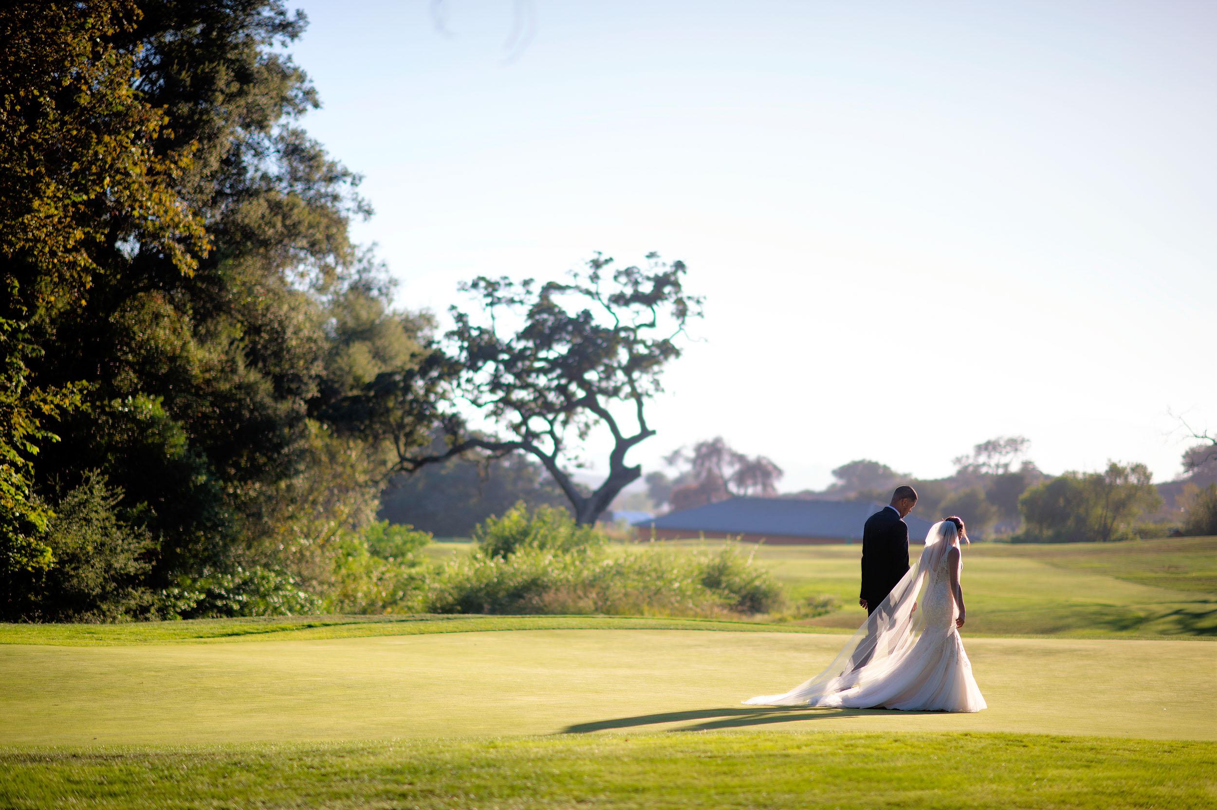 Bride and groom walking at CrossCreek Golf Club in Temecula.