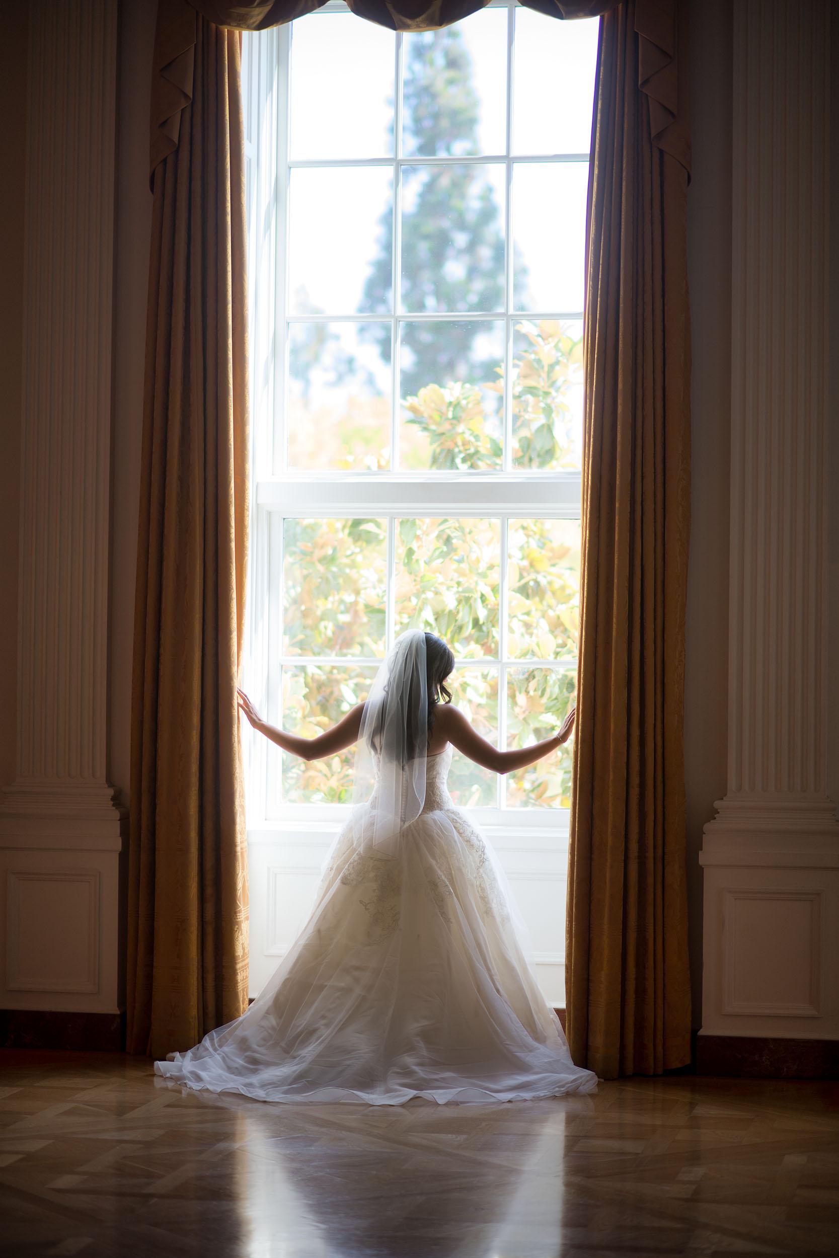 Bride backlit in window at the Richard Nixon Presidential Library & Museum in Yorba Linda.
