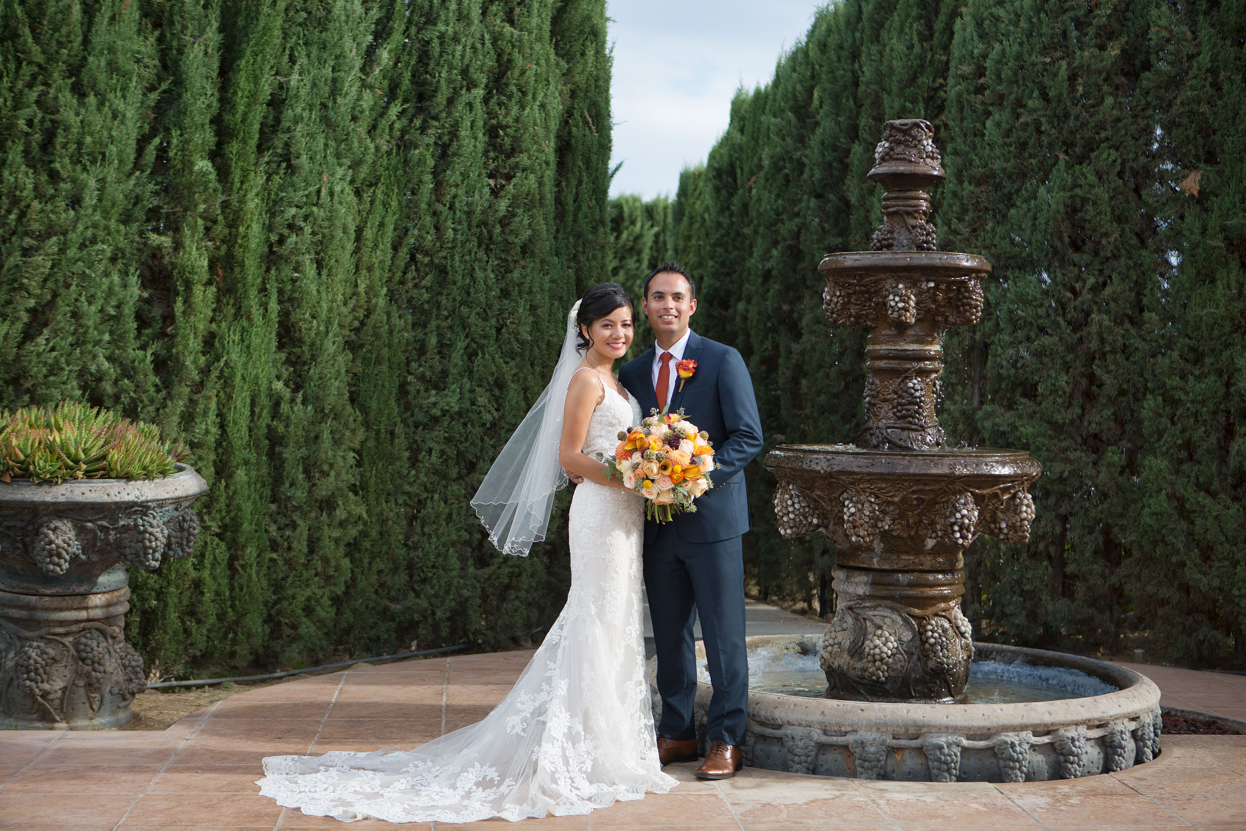 Bride and groom by fountain at Villa de Amore in Temecula.