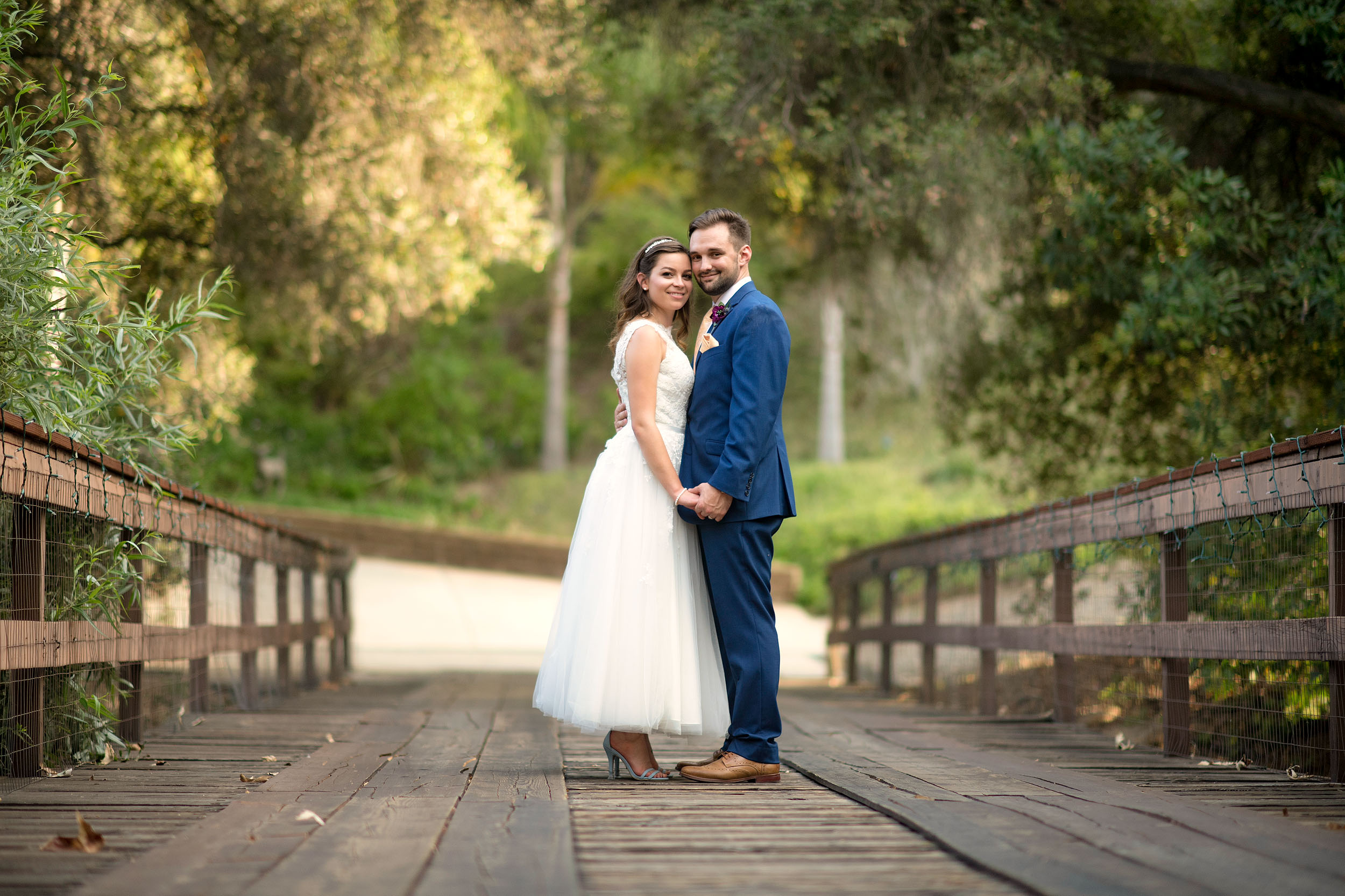 Bride and groom on bridge at Eden Oaks Ranch in Valley Center.
