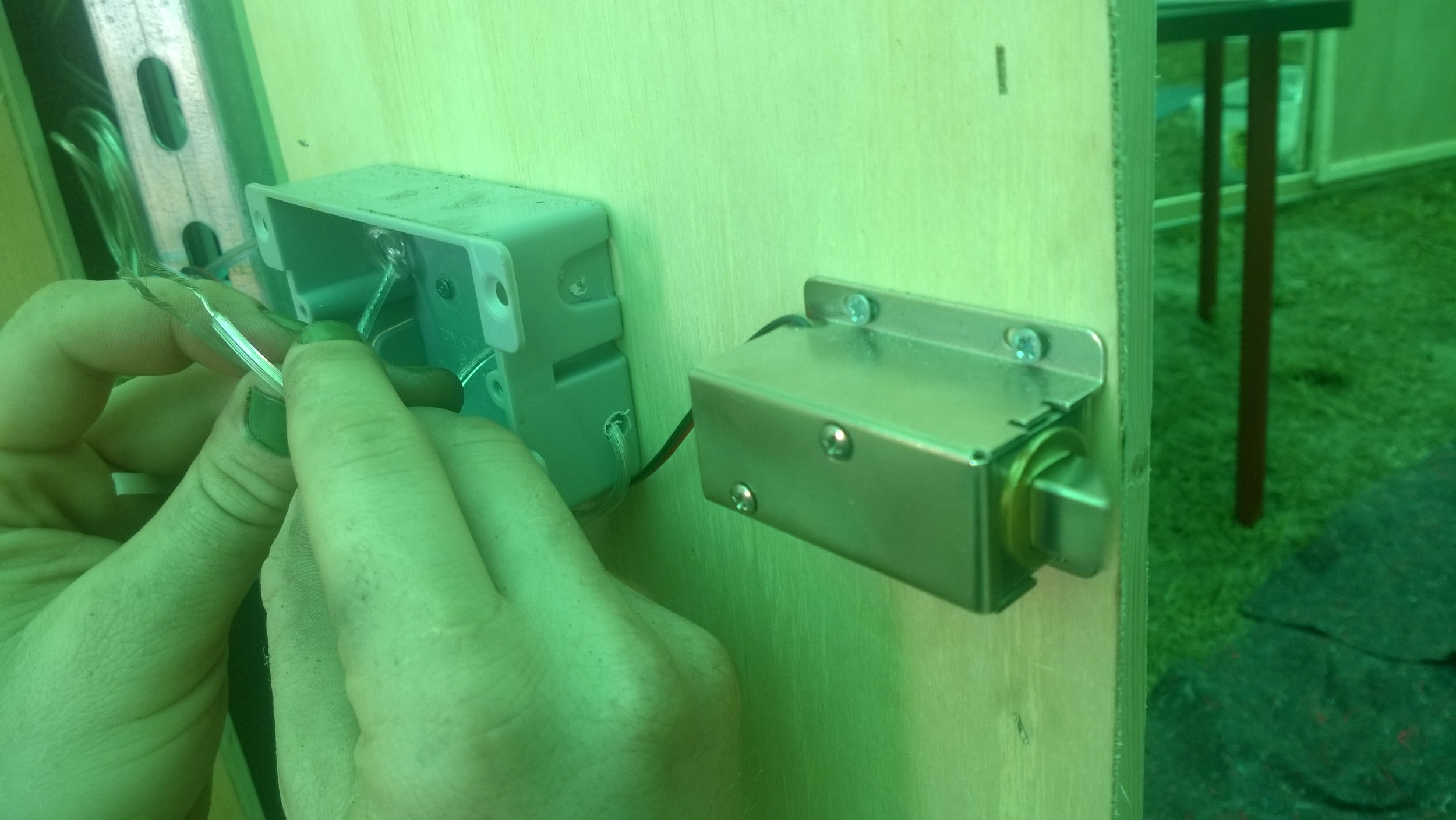 A lock which only opened by connecting two wires