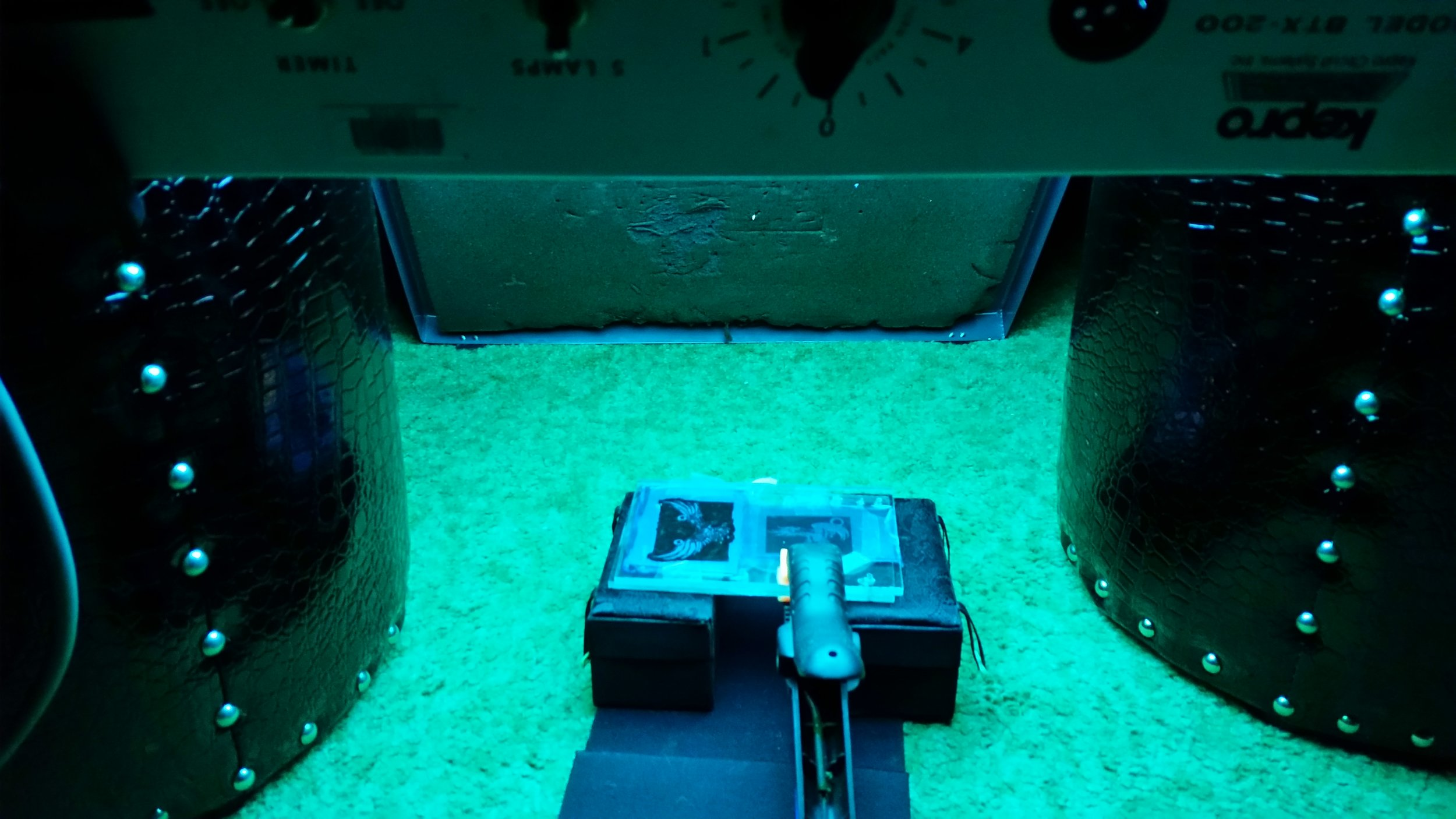 Step 3: Adhere a layer of photoresist to the metal. Use UV light exposure to transfer the transparency to the photoresist.