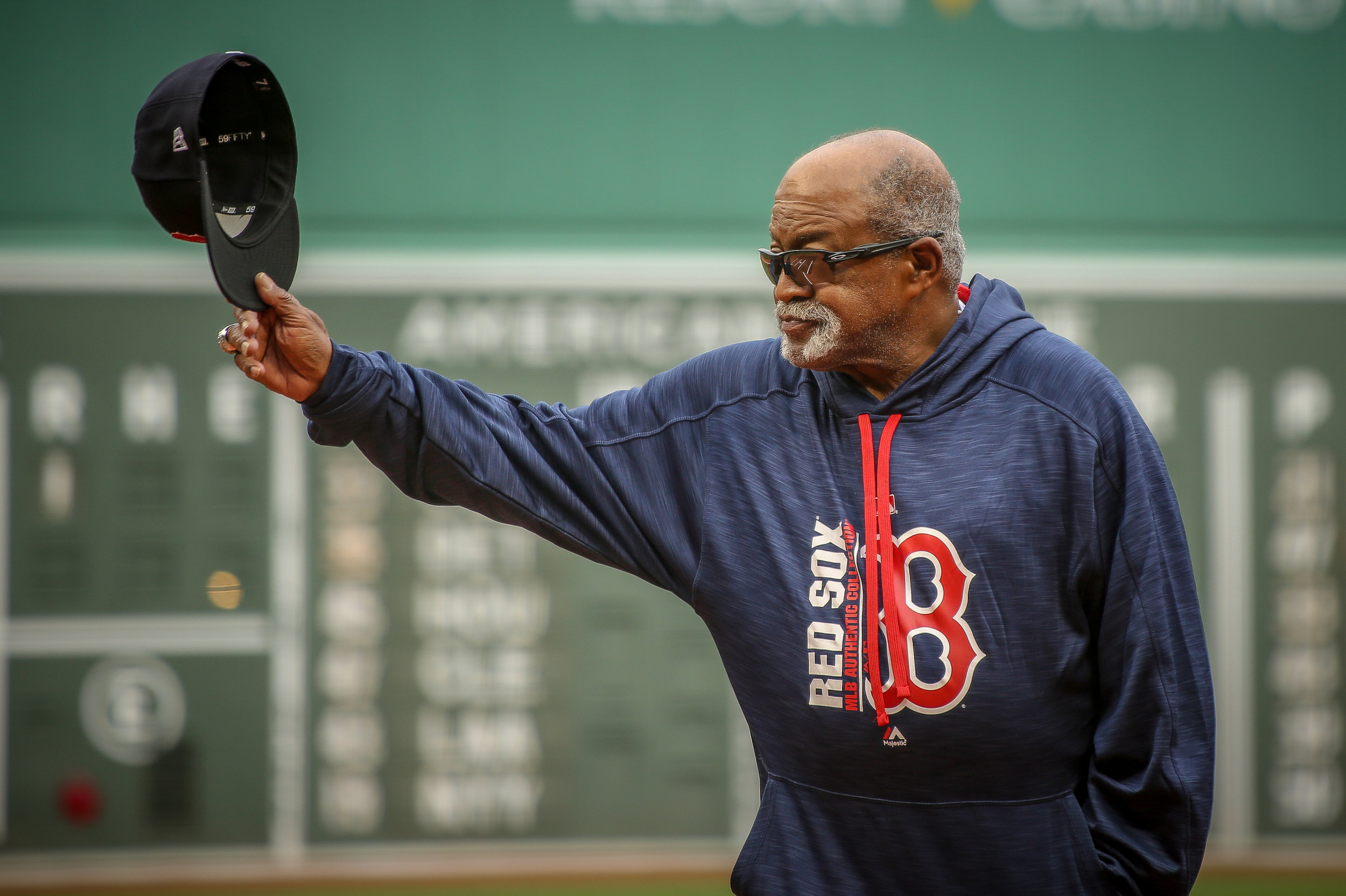 "Luis Tiant, Red Sox pitching legend, waves to the crowd at Fenway Park before the 2018 Alumni Game, where he was acting as a manager for  ""Team Tiant"" against Dwight Evans' ""Team Dewey."""