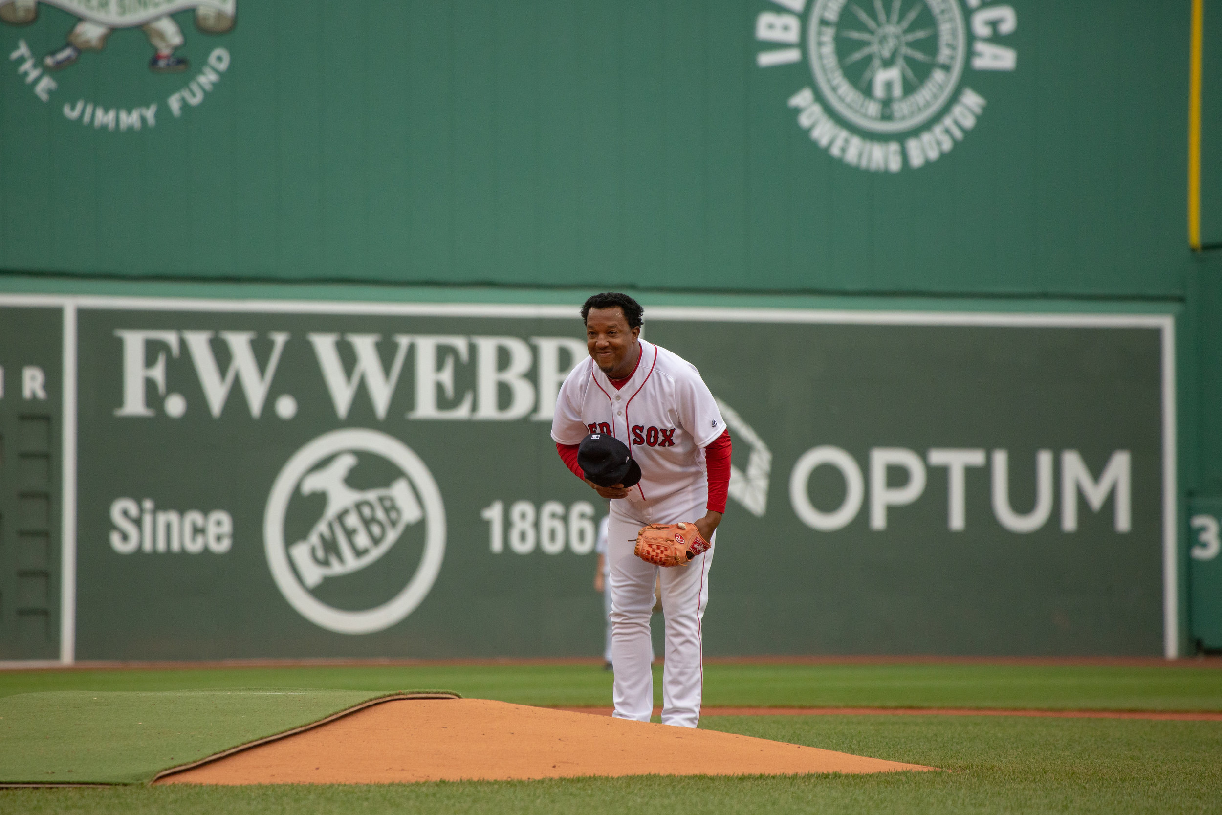 Hall of fame pitcher Pedro Martinez takes a bow to the crowd and batter as he steps to the mound during the 2018 Red Sox Alumni Game.