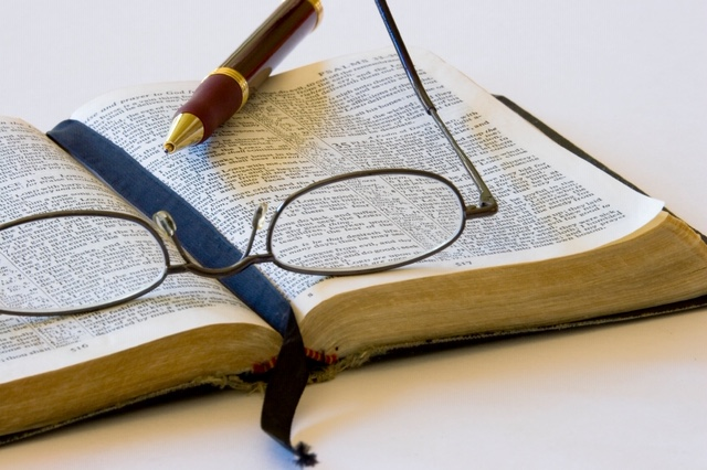 a bible pen and glasses.jpg