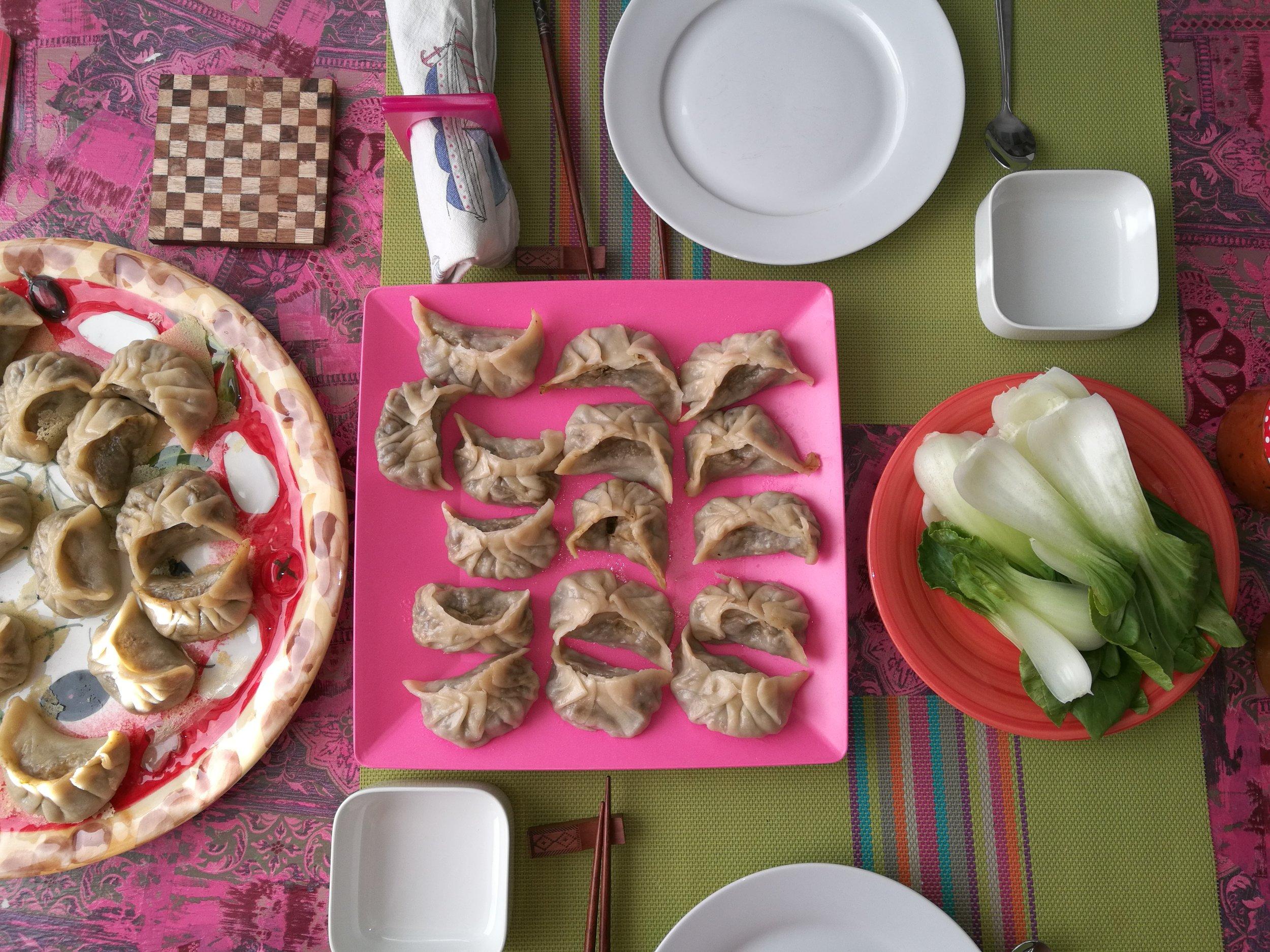 Homemade vegan momos with steamed pak choi