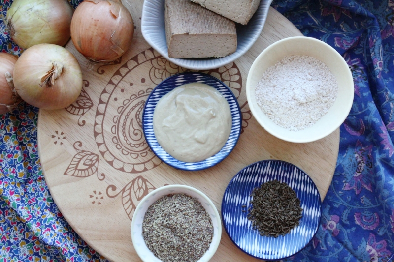 Key ingredients for vegan onion pie/Zwiebelkuchen – onions, smoked tofu, cashew butter, flour, flax seeds and caraway seeds