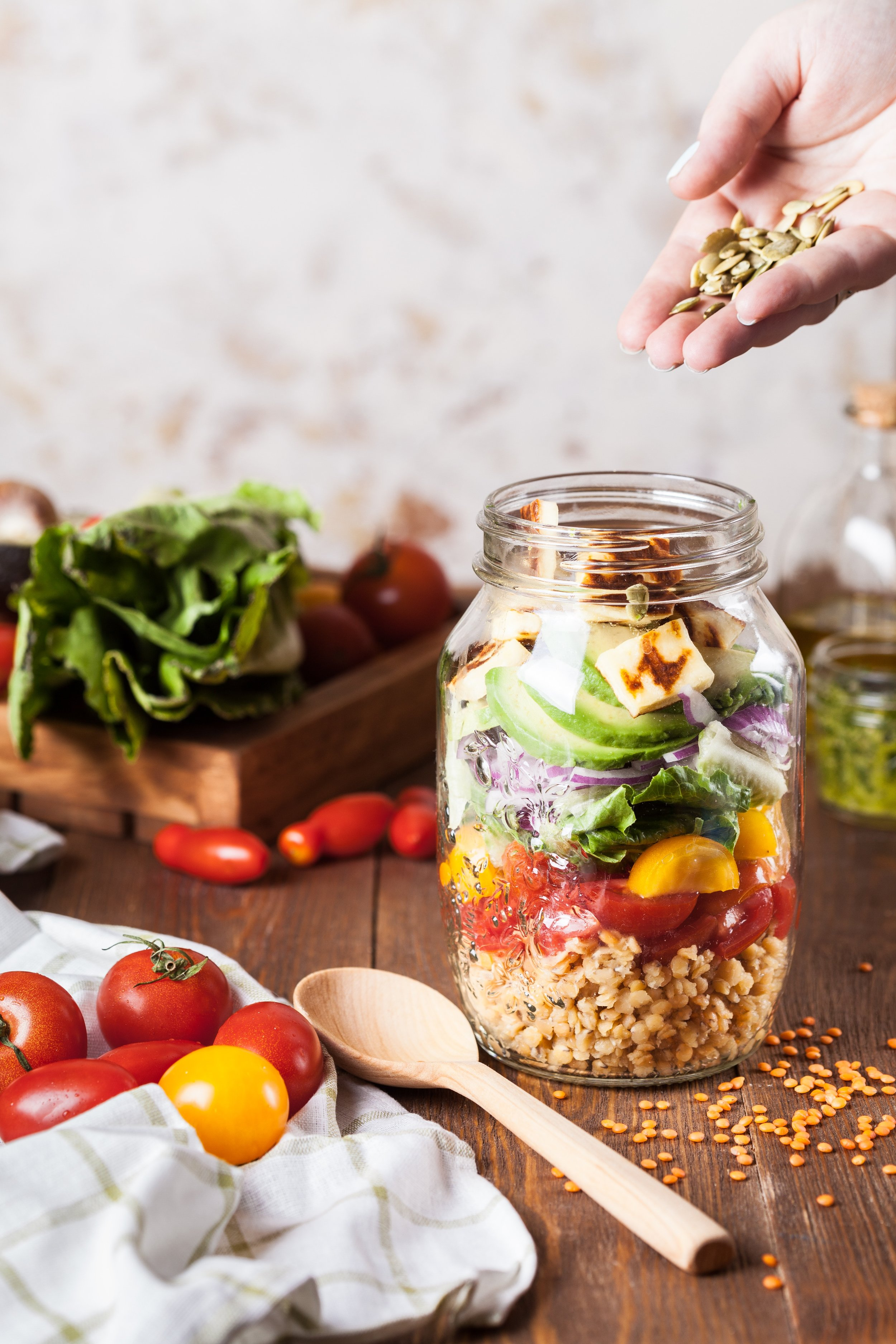 You can store your salads in mason jars and stack them up in the fridge to save space.