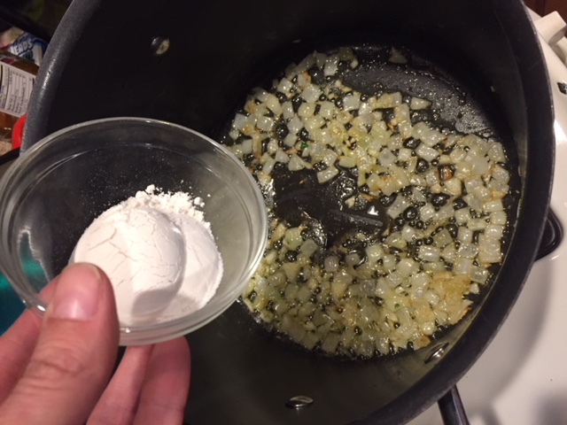 Adding flour to garlic and onions