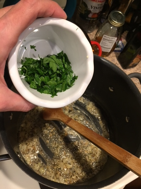 Adding parsley and basil