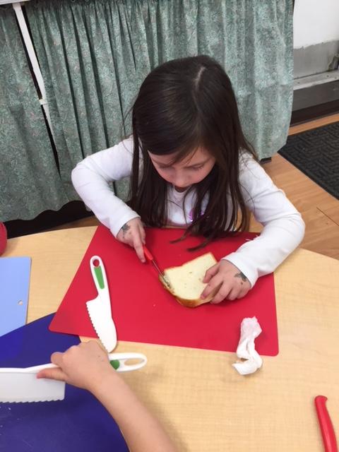 Kids cutting bread