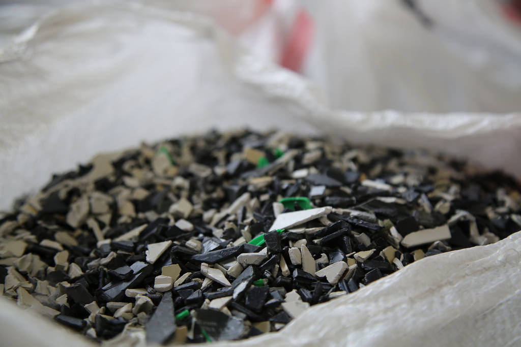 Bits and pieces of plastic from electronic waste, now safely ready to be recycled.