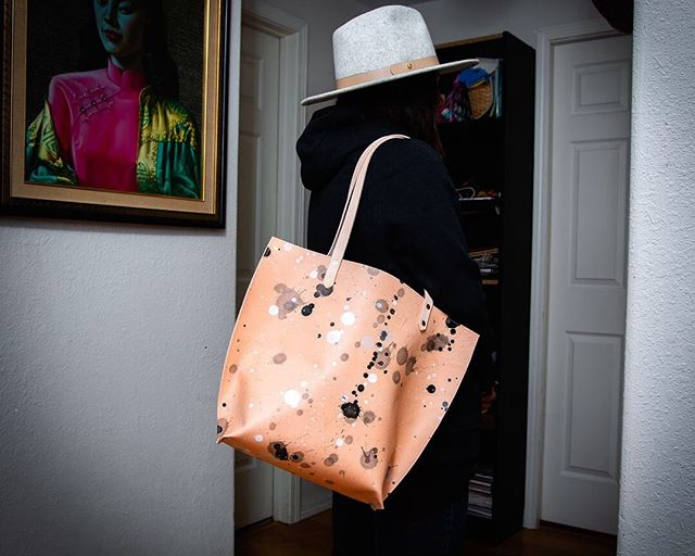This tote from a new batch of leather I painted a few weeks ago.  The paint is a little lighter than previous bags and has bigger spots.  I LOVE it!! These bags are so fun because each one is different - they are hand painted little works of art and I am obsessed.  I hope you will be too, more are on the way!  DM to purchase Photo @shawn_hale_photo  #handpainted #handpaintedleather #handpaintedleatherhandbag #streetart #paintdrip #splatter #paintsplatter #Jacksonpollock #limitededition #smallbatch #individuallycrafted #handcrafted #craftsmanship #customleather #customleatherwork #customleathergoods #bespokeleather #bespokeleathergoods #luxuryleathergoods #custommadeleather #luxeleather #handsandhustle #makersgonnamake #makerfaire #makermovement #modernmaker #meetthemaker #makerlife #femaleentreprenuer #bossbabe