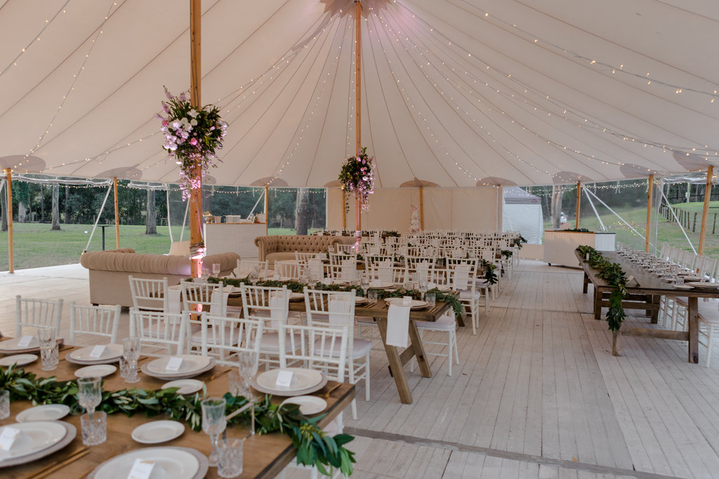 Wooden-feasting-tables-greenery-garlands-HT-Events.jpg