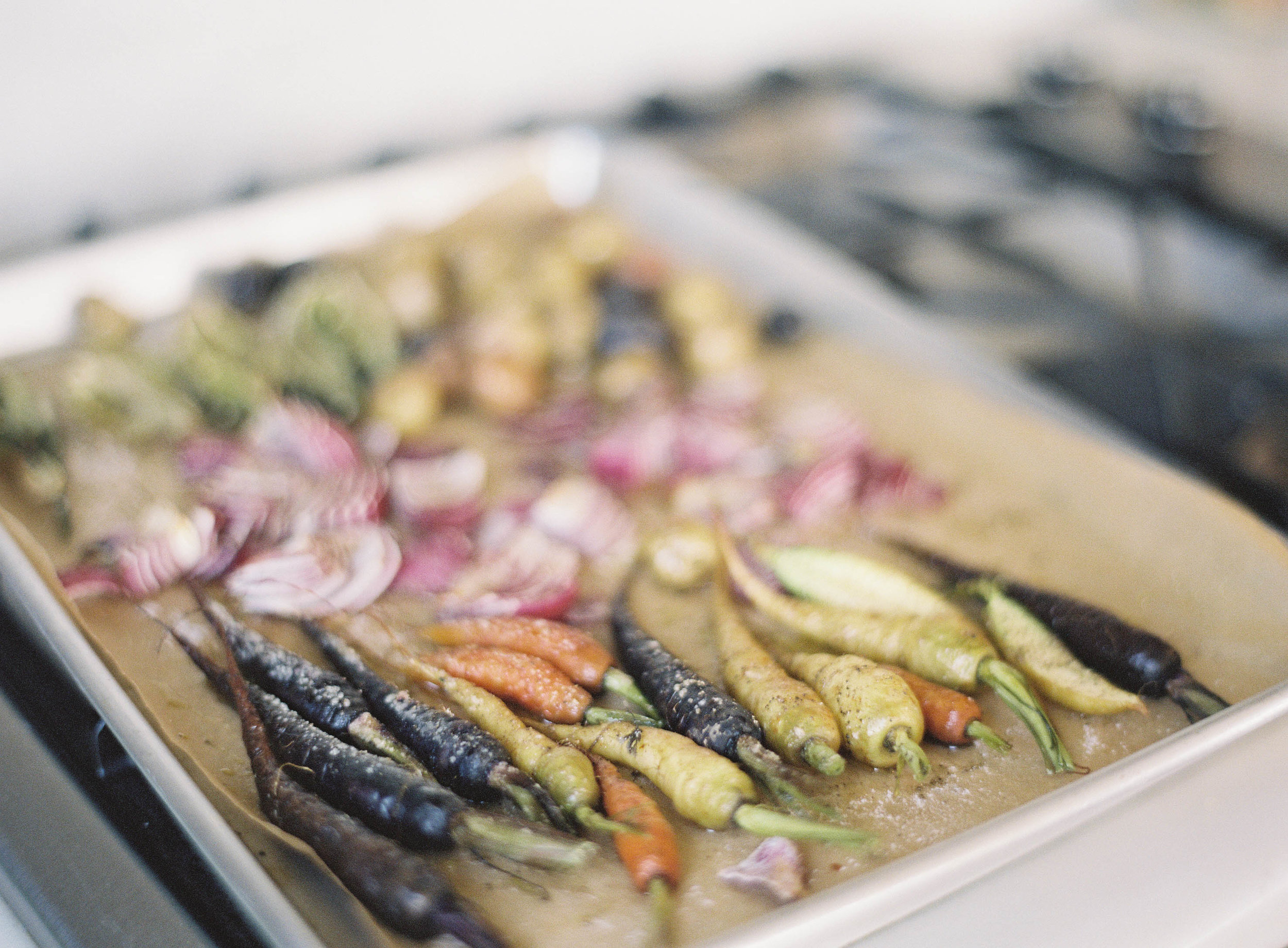 4. - Roast. Cover several cooking pans with wax paper and arrange your vegetables and garnishes on them. Wrap your fish in foil on another pan. Roast the vegetables in the oven at 450 degrees for 20 minutes, stirring occasionally. Bake your fish for 15 minutes (although you may want to adjust the timing based on the size of your fish).