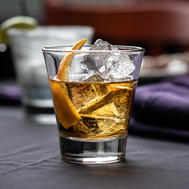 Old Fashioned - Rye bourbon, aromatic, & orange bitters, simple syrup, with orange peel garnish.