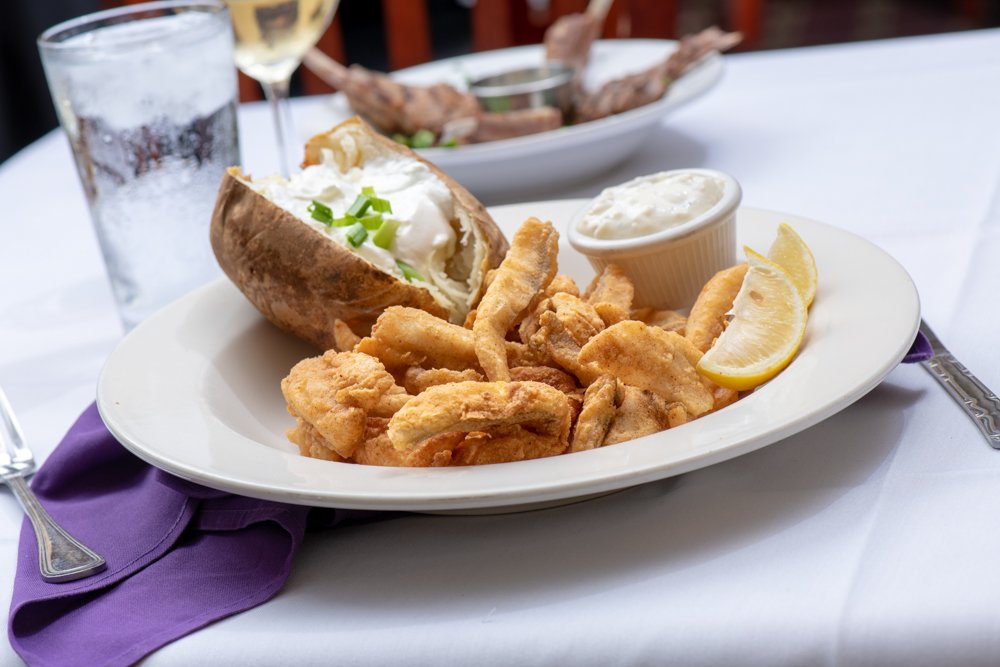 ½ POUND LAKE PERCH - Young's battered lake perch served with tarter or cocktail sauce, served with a side and a cup of soup or salad.