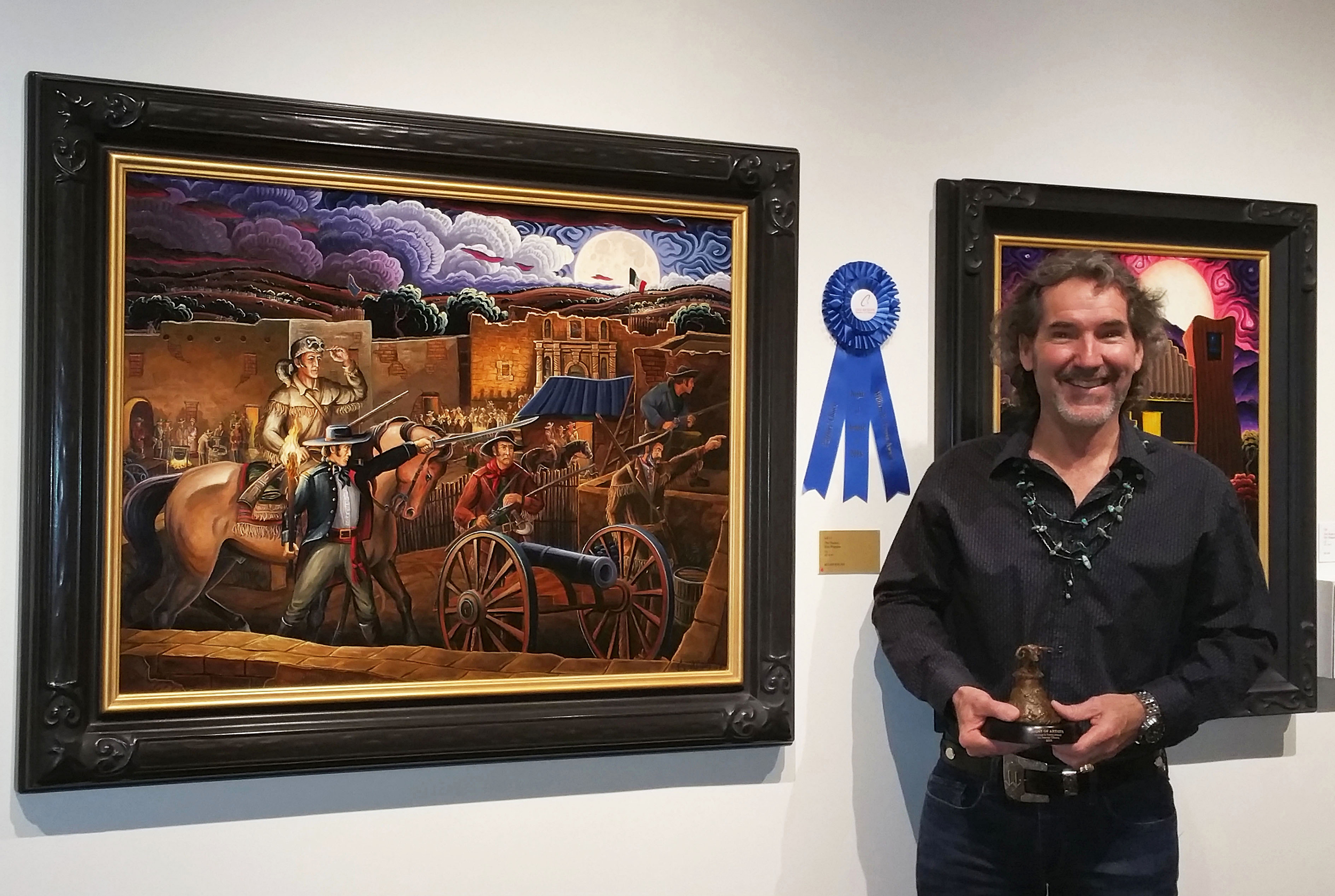 I'm standing with The William B. Travis Award for Patrons' Choice in front of my award winning work, The Texians, Oil, 30 x 40.
