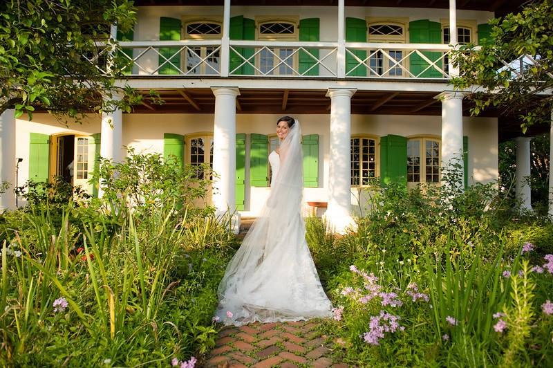 Bride in front of house.jpg