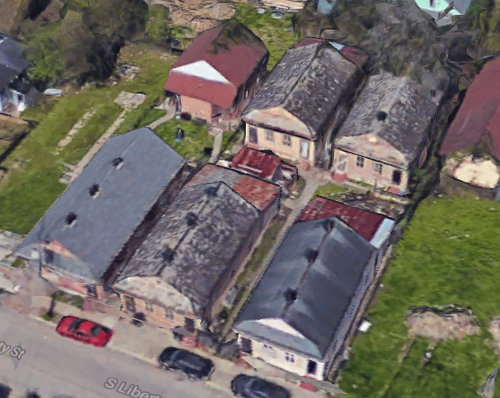 An overhead view of the six cottages being renovated in the 3400 block of South Liberty Street. (via Google)
