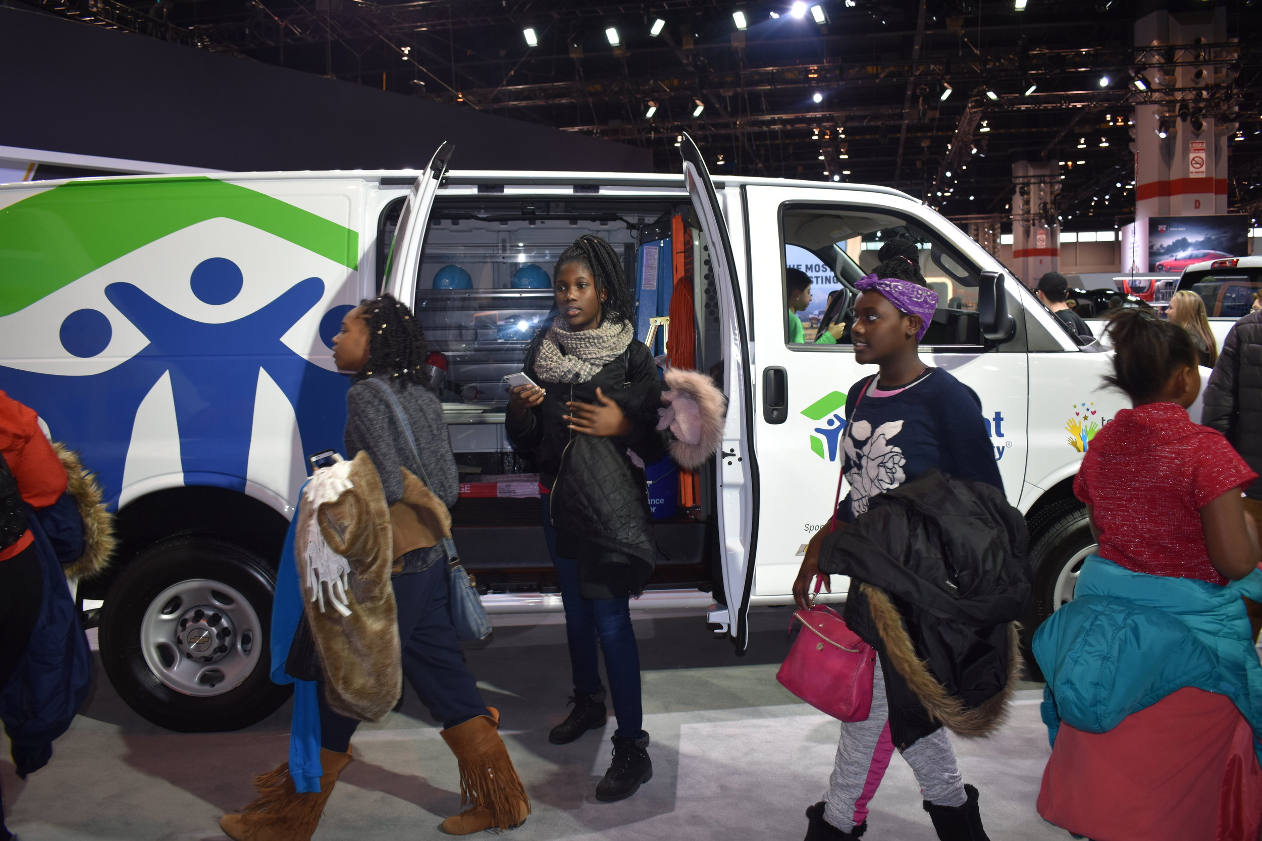 Girls exploring the floors of the Chicago Auto Show!