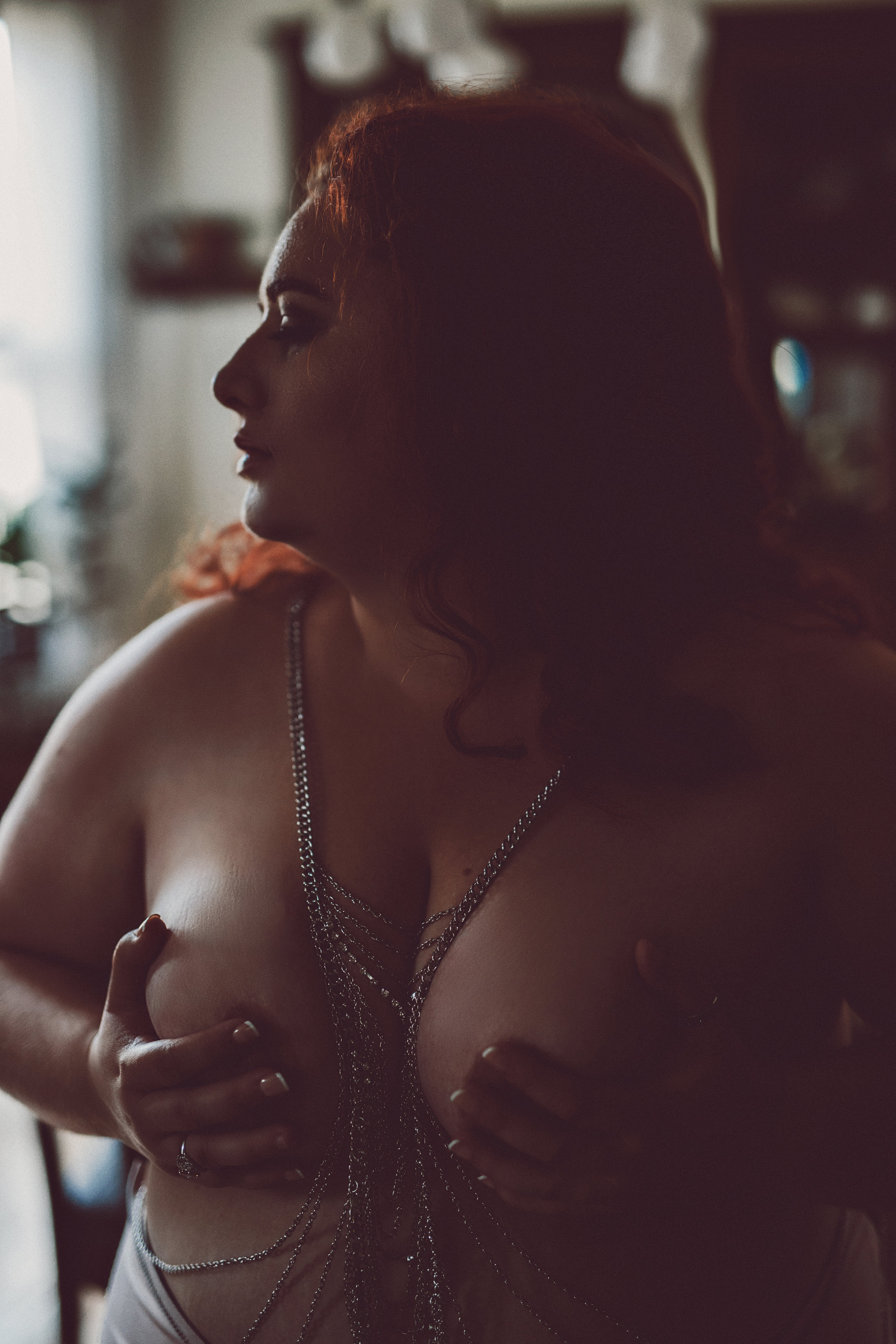 profile with body chain topless
