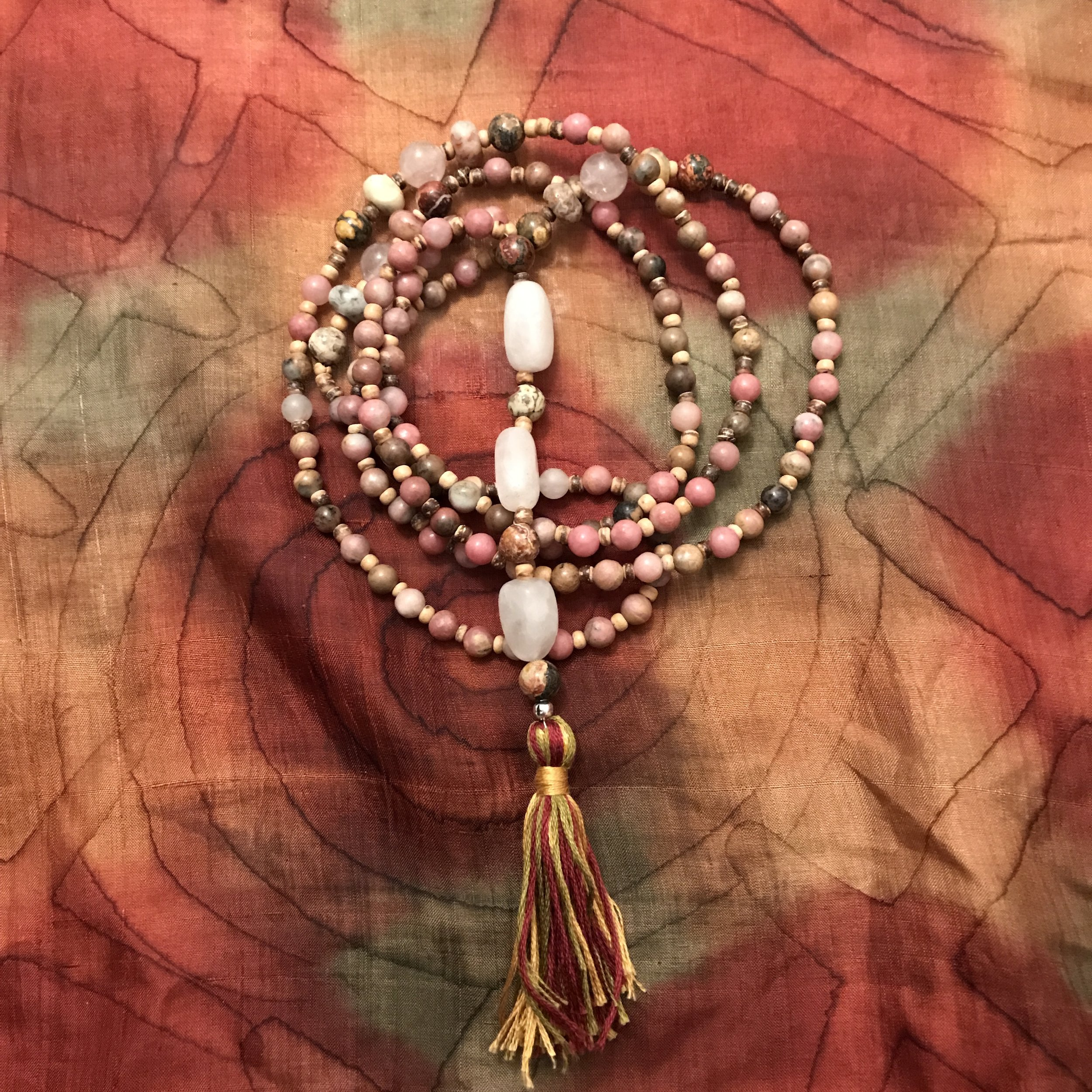 Open Heart Mala fashioned for Rob Bell. Materials used are Rhodonite Jasper, Jaguar Stone, Agate, Quartz, and Rose Quartz. 108 blessings were spoken over Rob during its creation.