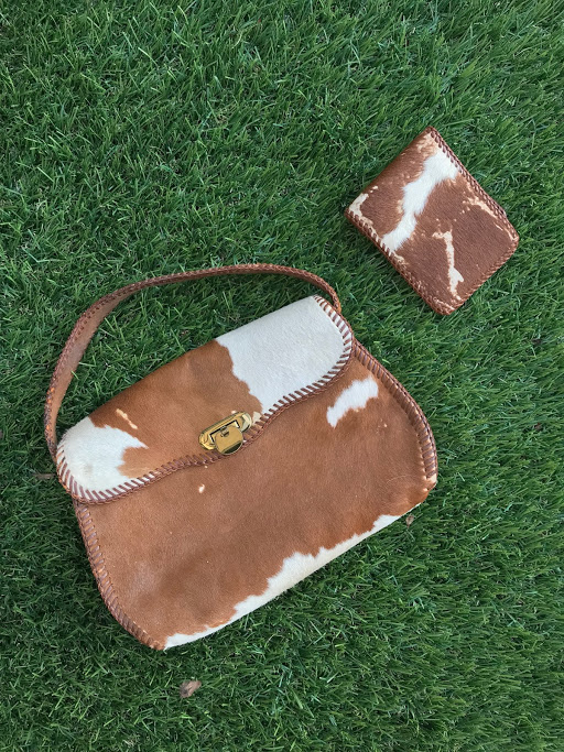 Cow-Hide Purse - My cow-hide purse! It was $45 WITH the wallet from Willow House in Shelburne, one of my favorite antique stores which I wrote about last year for The Shelburne News.