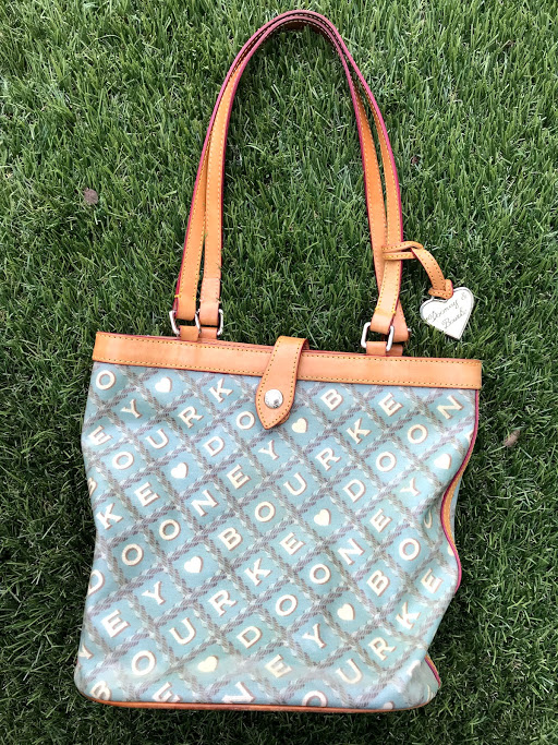 Dooney Bourke - My beloved Dooney Bourke bucket bag, with pink gingham inside! (I am always a fan of gingham or buffalo check...) I don't remember what I paid for it, but I do remember it was a steal. And I found it in a thrift store that's now closed in my hometown of Northampton, MA.