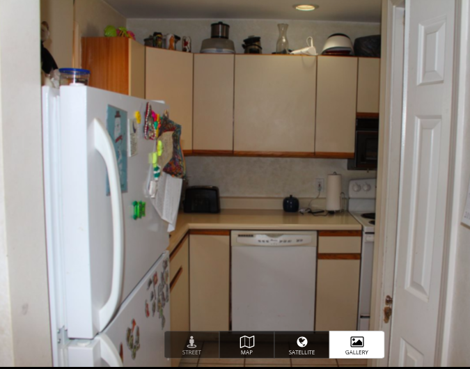 """This is the view you see to your left when you walk into my condo (that door to the right of the picture is my pantry. ( Check out the refresh post here! ) Oh, and when I moved in that refrigerator was broken BTW, so the """"after"""" photo next does include a new-and bigger-fridge!"""