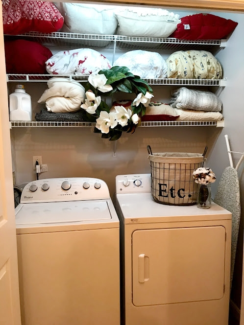 Totally styled and put back together -- color is on the wall, though the fluorescent lighting in my laundry room does not help this picture (or the following pictures—sorry!). Also farmhouse accessories are in place!