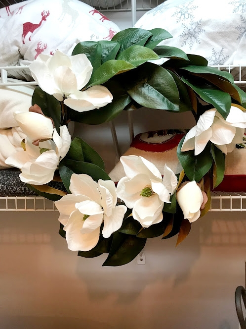 I LOVE this magnolia wreath #JoannaGaines and it was on sale for $12!!!! CRAZY. I ALWAYS recommend shopping the sale section at Michaels. This wreath was originally $59.99 and was marked down marked down for $12. (I'm holding the receipt right now and it's still making me happy!) I also got it to stay put with green craft wire. I think the center placement on the shelves feels just right!