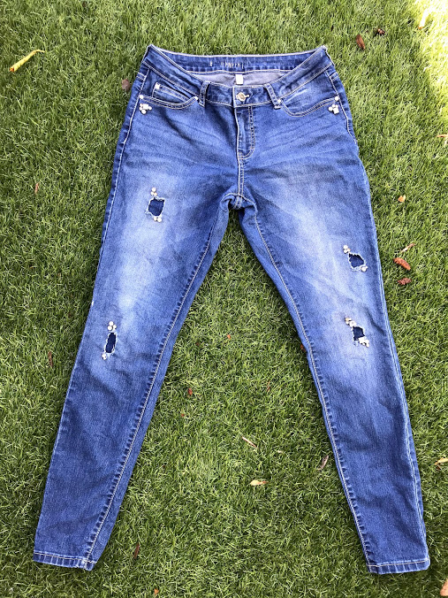"""Well, this is really as """"ripped up"""" as I get with jeans, and as you'll notice these jeans have jewels sewn into them! So, totally my own take on #prairiestyle here, but I'm still loving them.  Price? $14.59! They're actually J-Lo brand jeans (yes, the singer!) in case you want to try and find some like these.  I will add: the best pair of jeans I ever got were $5 bell-bottoms, dark-wash, also at a thrift store, but these are my next favorite. And just add the frilly top with my new shoes or a plaid shirt and I'm walking in #prairiestyleallday."""