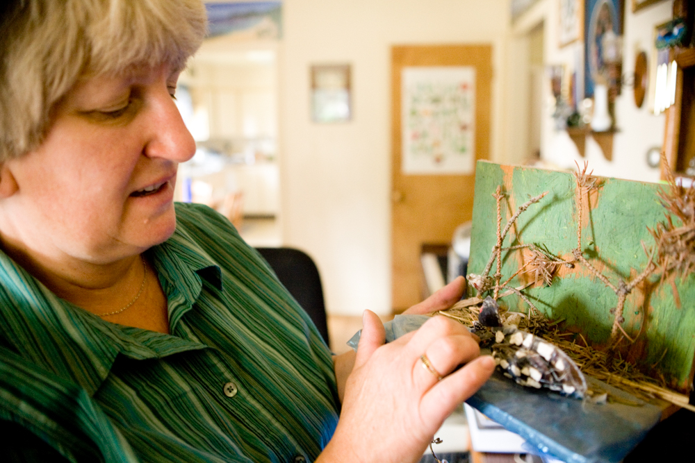 """Love acknowledges that she is a little """"loony."""" """"People just keep giving me loons,"""" she says, showing off a diorama featuring a loon made by her daughter Laura Love, who is 24. Donna Love is the secretary for the Montana Loon Association, and helps identify and keep loons in Seeley Lake. Seeley Lake currently has one nesting pair of loons."""