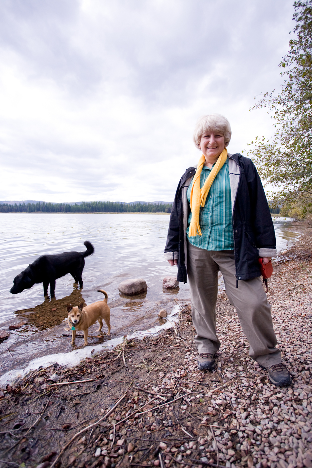 """As part of her daily routine, Love takes her chihuahua mix, Ginger, for a walk near the lake. The neighbor's dog, Ky, often joins them. """"I spend my day in nature,"""" Love says. She uses her walks as part of the creative process, and takes time to observe any wildlife she sees on the way."""