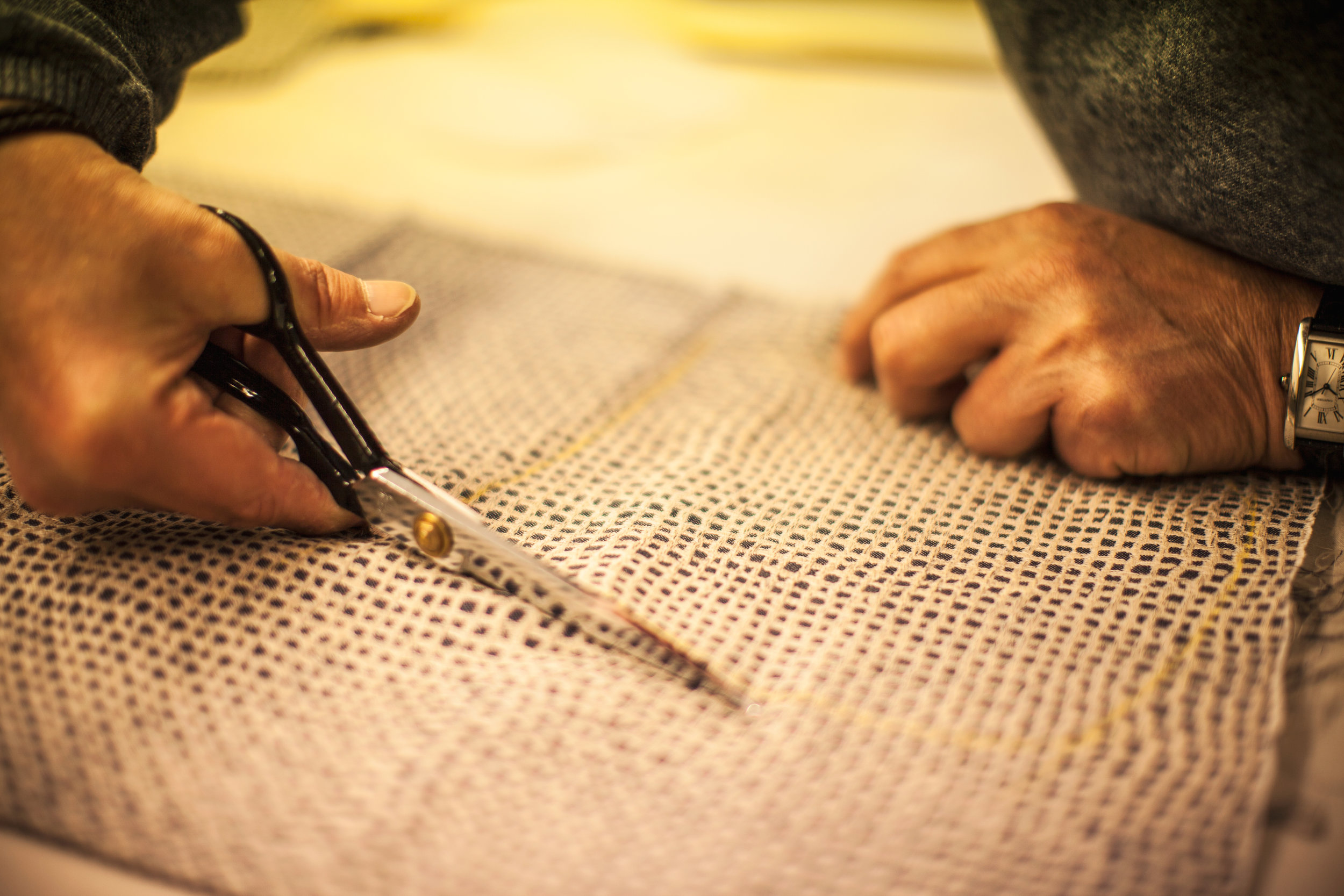 Cutting - Every client has their own recorded paper pattern based on the initial set of measurements which is subsequently hand cut and refined through the fitting process. Aside from the pattern cutting, the canvassing is another crucial element in the process of creating our bespoke suits. Canvassing is the art of creating a horsehair hand stitched base that forms the shape of the client's bespoke coat and will mould to their physique with wear. This floating canvassed base gives all our suits a natural feeling and comfort.