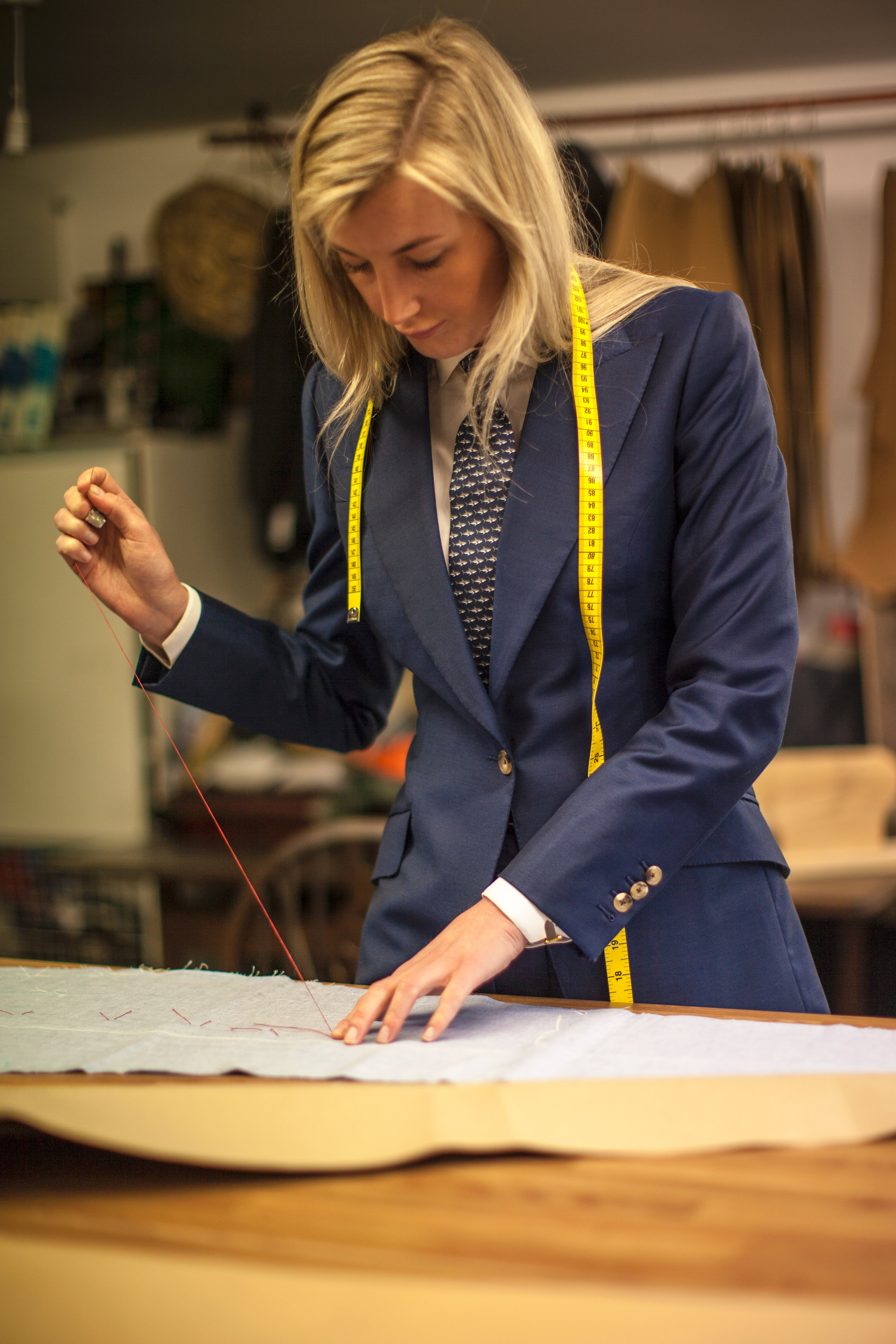 Completion - Caroline Andrew London bespoke suits take around 75 hours to complete over a period of 8-10 weeks. They are hand finished, complete with buttons and buttonholes strengthened with Beeswax adhering to long standing industry tradition. The suit goes through its final stage where the specially trained presser completes the process by moulding, steaming and pressing the suit into its final form ready for the customer.