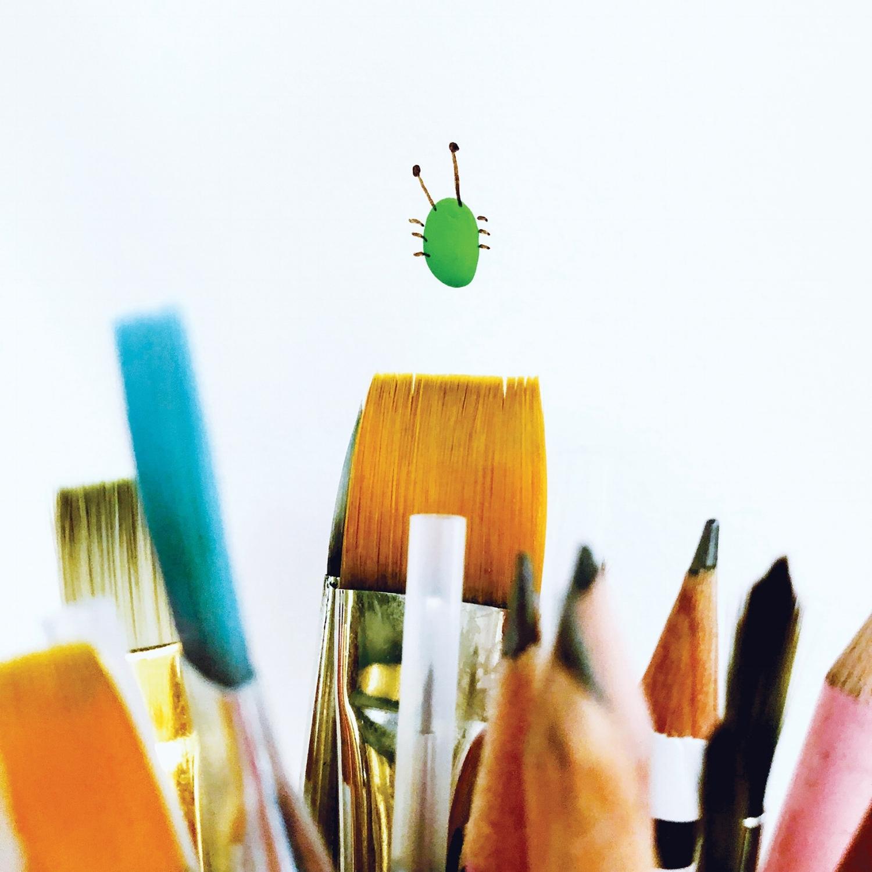 a green paint splatter becomes a cute critter