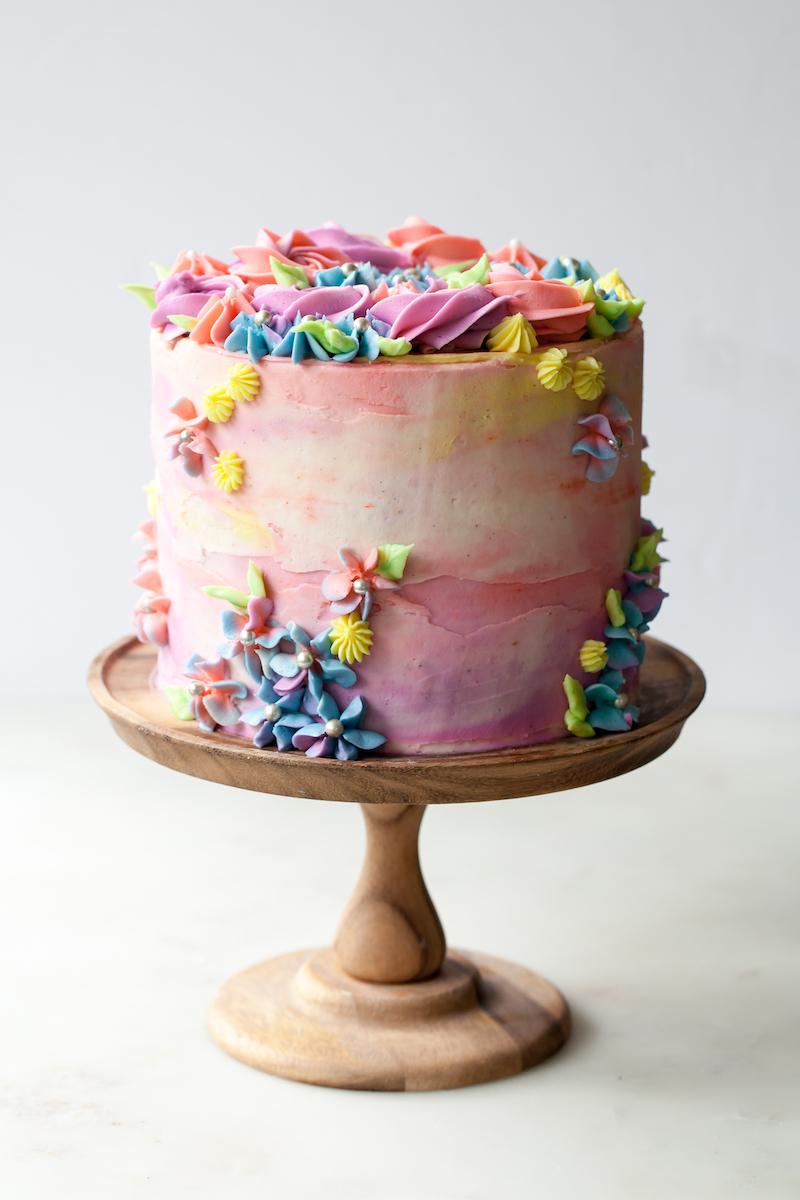 Sprinkle+Birthday+Cake+with+vanilla+pastel+buttercream+swirls.jpg